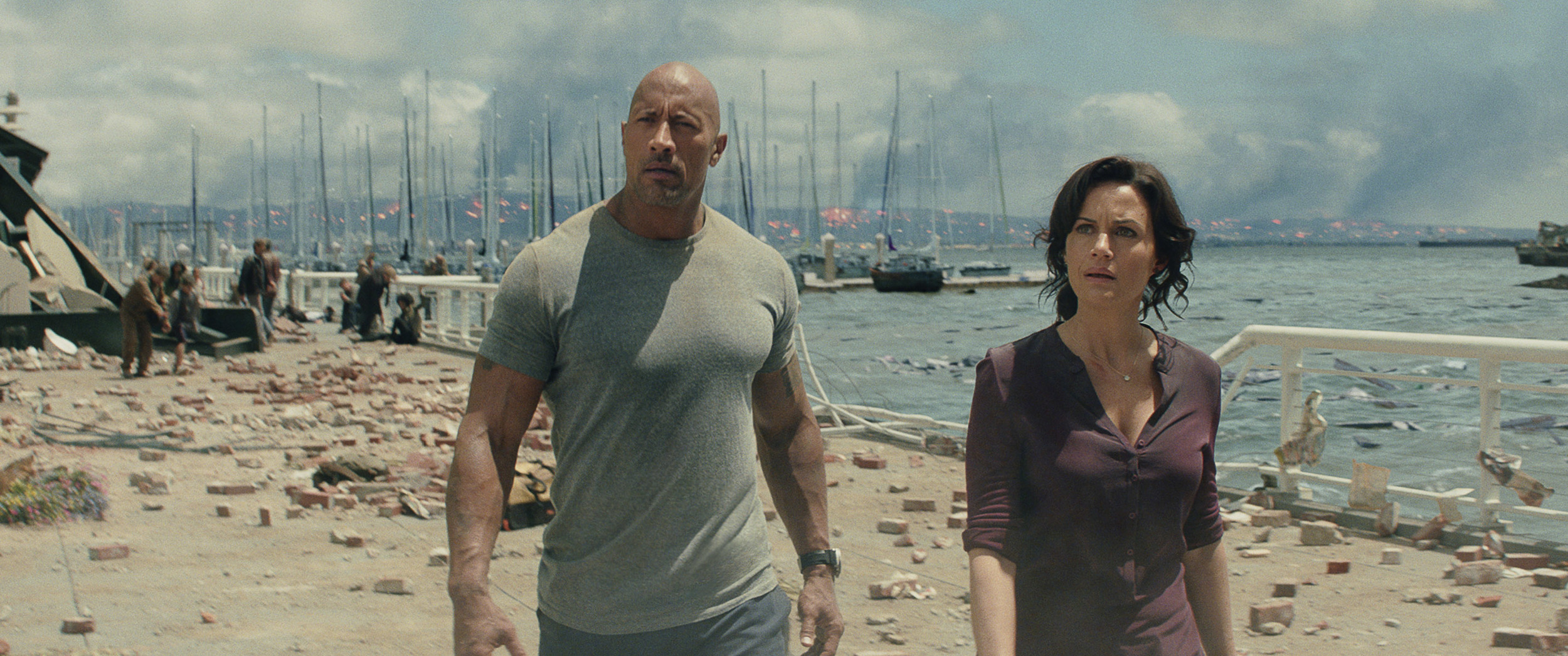 The Rock and Carla Gugino do a decent job of reacting to things that aren't there. (Warner Bros. Pictures)