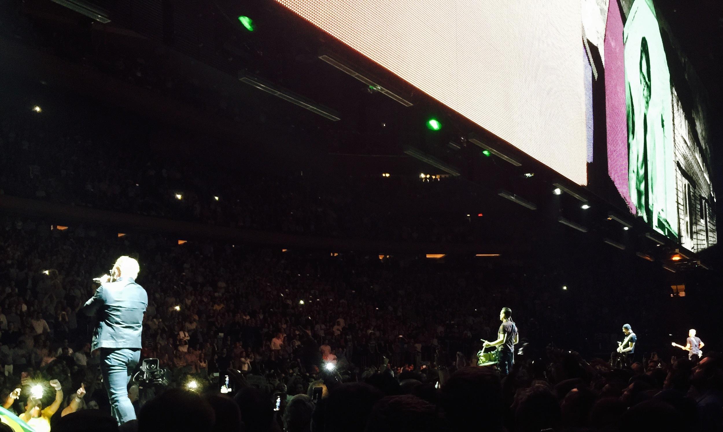 "Bono, Larry Mullen, Jr., The Edge, and Adam Clayton perform ""Sunday Bloody Sunday."""