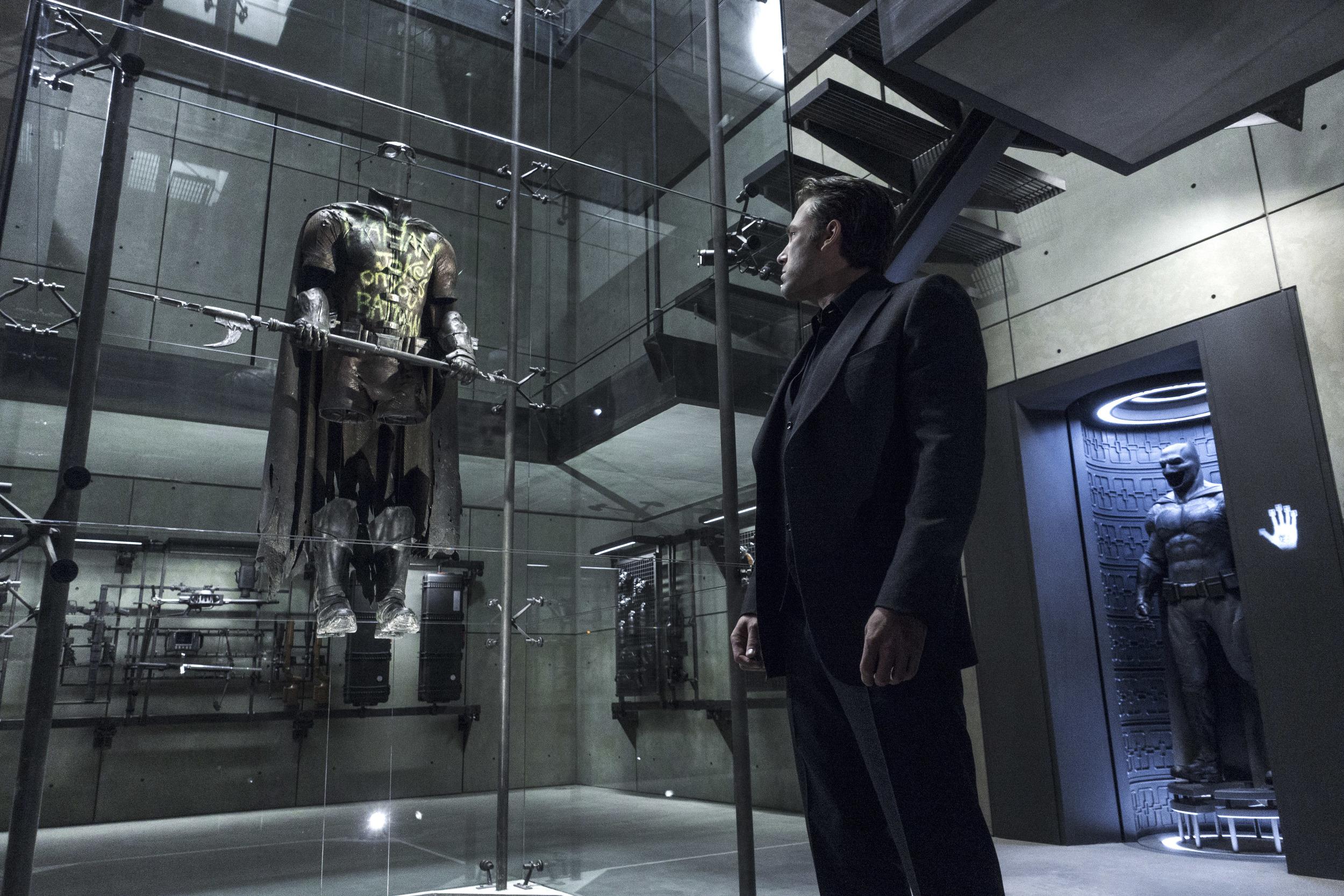 Ben Affleck's Bruce Wayne remembers his fallen partner Robin in  Batman v Superman  (Warners).