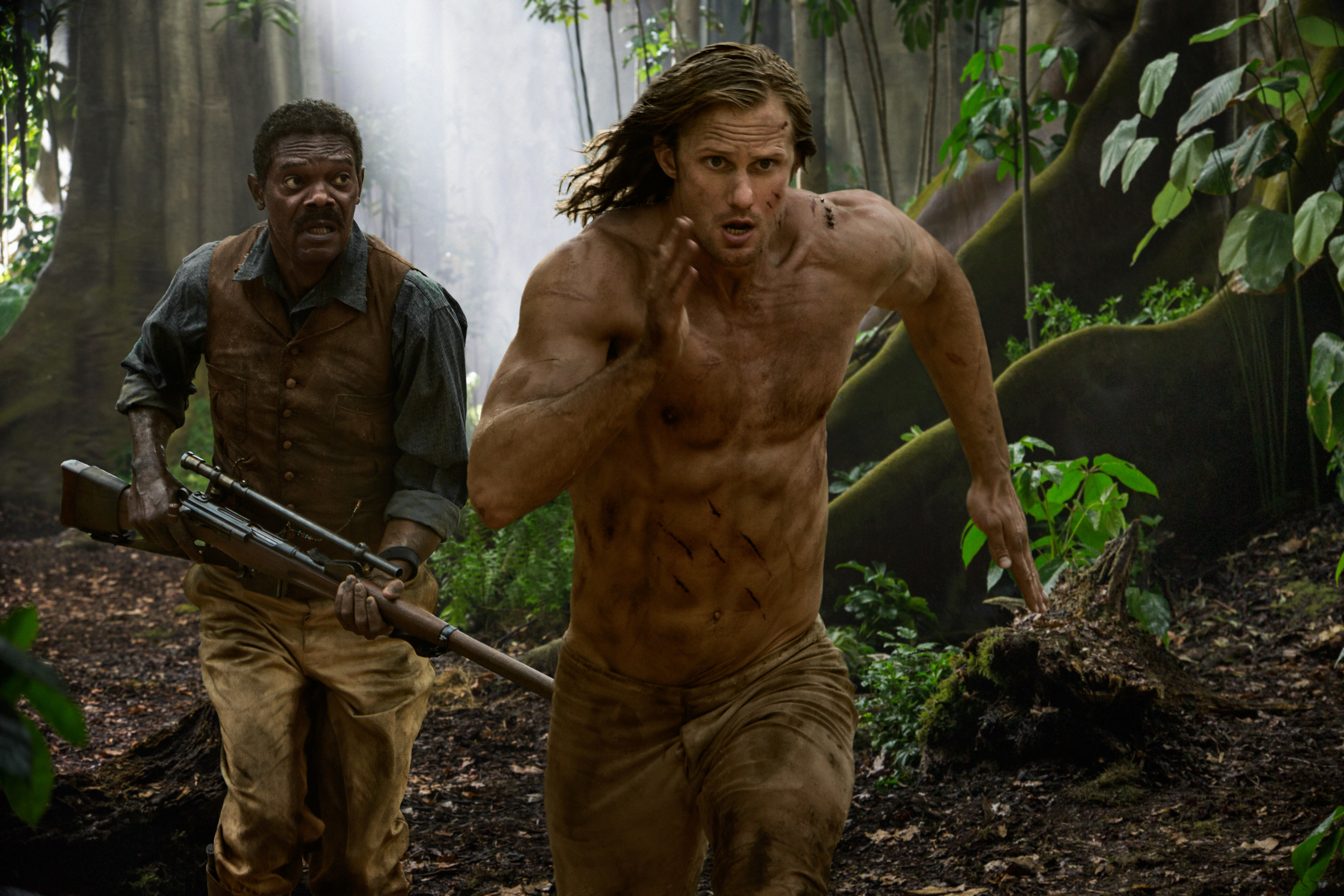 Samuel L. Jackson as real-life Renaissance man George Washington Williams, with Alexander Skarsgård as fictional he-man  Tarzan.  (Jonathan Olley)