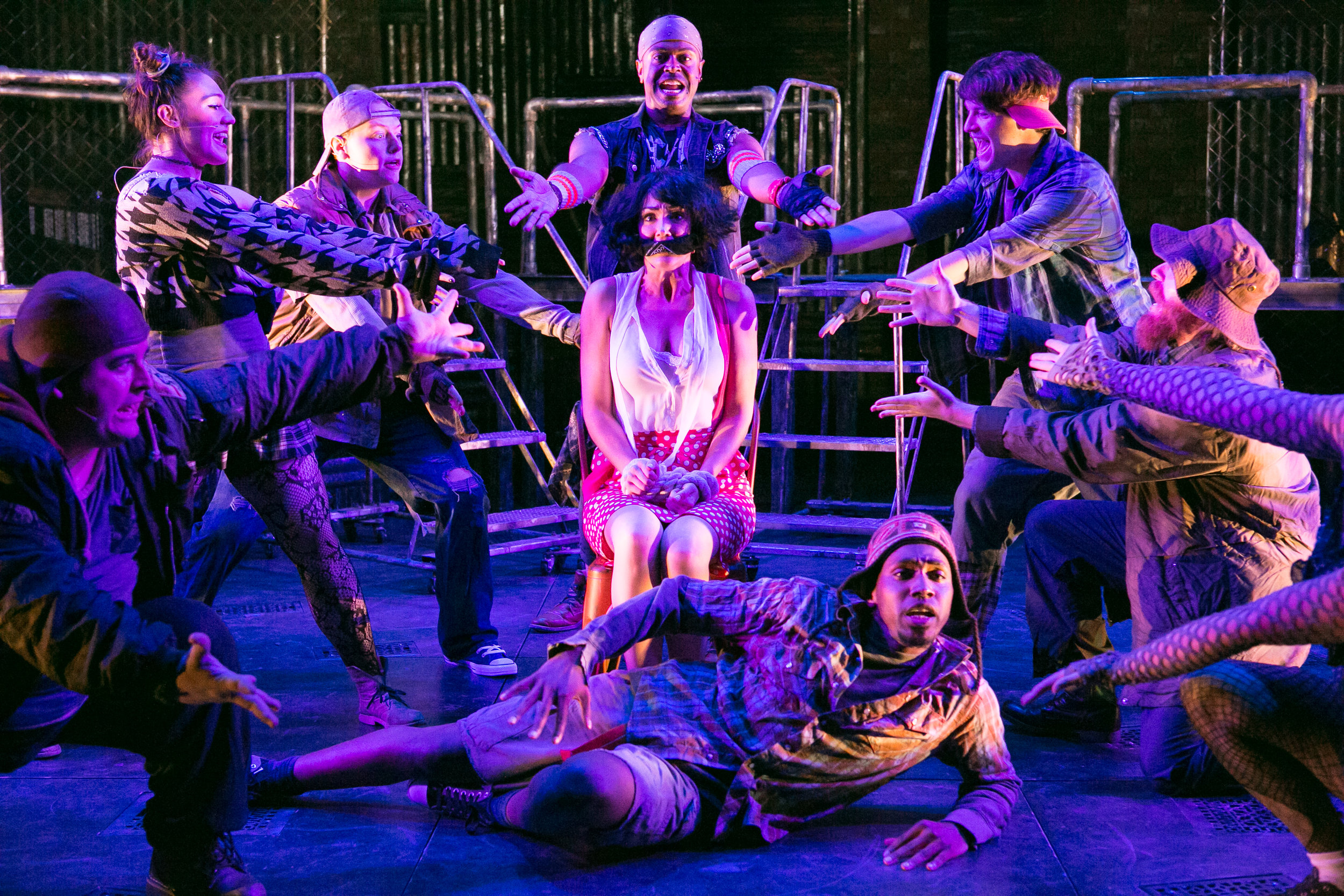 Rick Westerkamp, Emily Madden, Harrison Smith, Patrick Murphy Doneghy, Katie Keyser (center), Christian Montgomery, Matthew Aldwin McGee, and Carl Williams in  Urinetown.  (Daniel Schwartz)