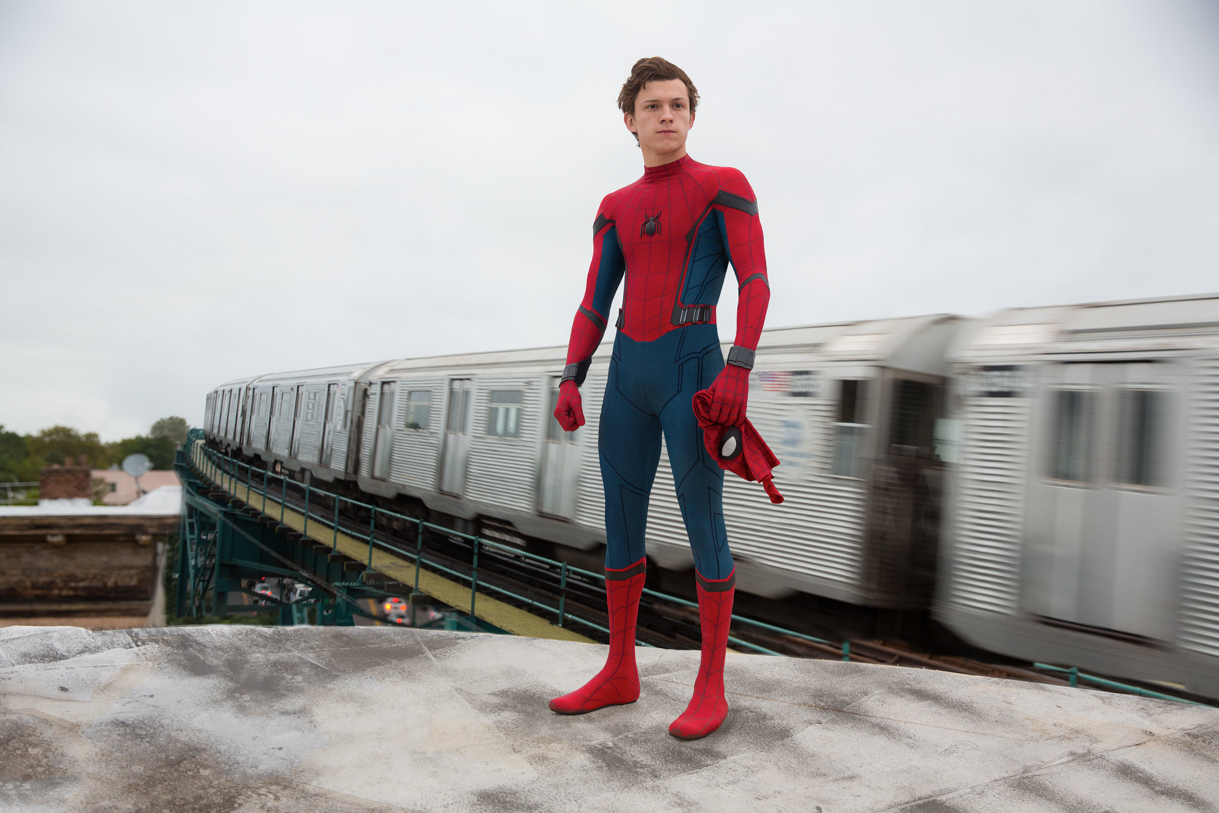 Tom Holland's Peter Parker oughtta be more careful about where he removes his mask. (Sony)