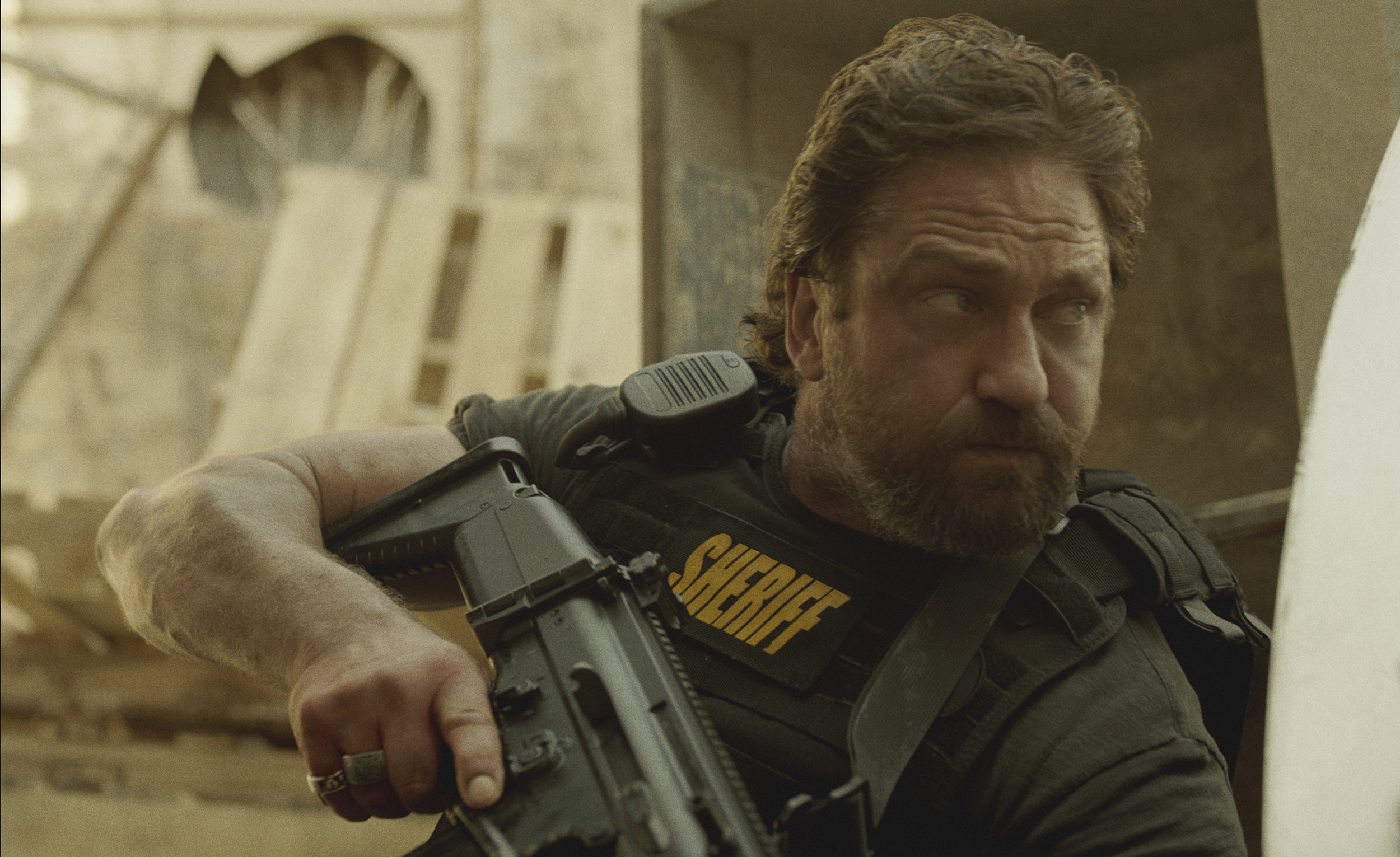 He's the Sheriff: Gerard Butler, under fire. (STX)