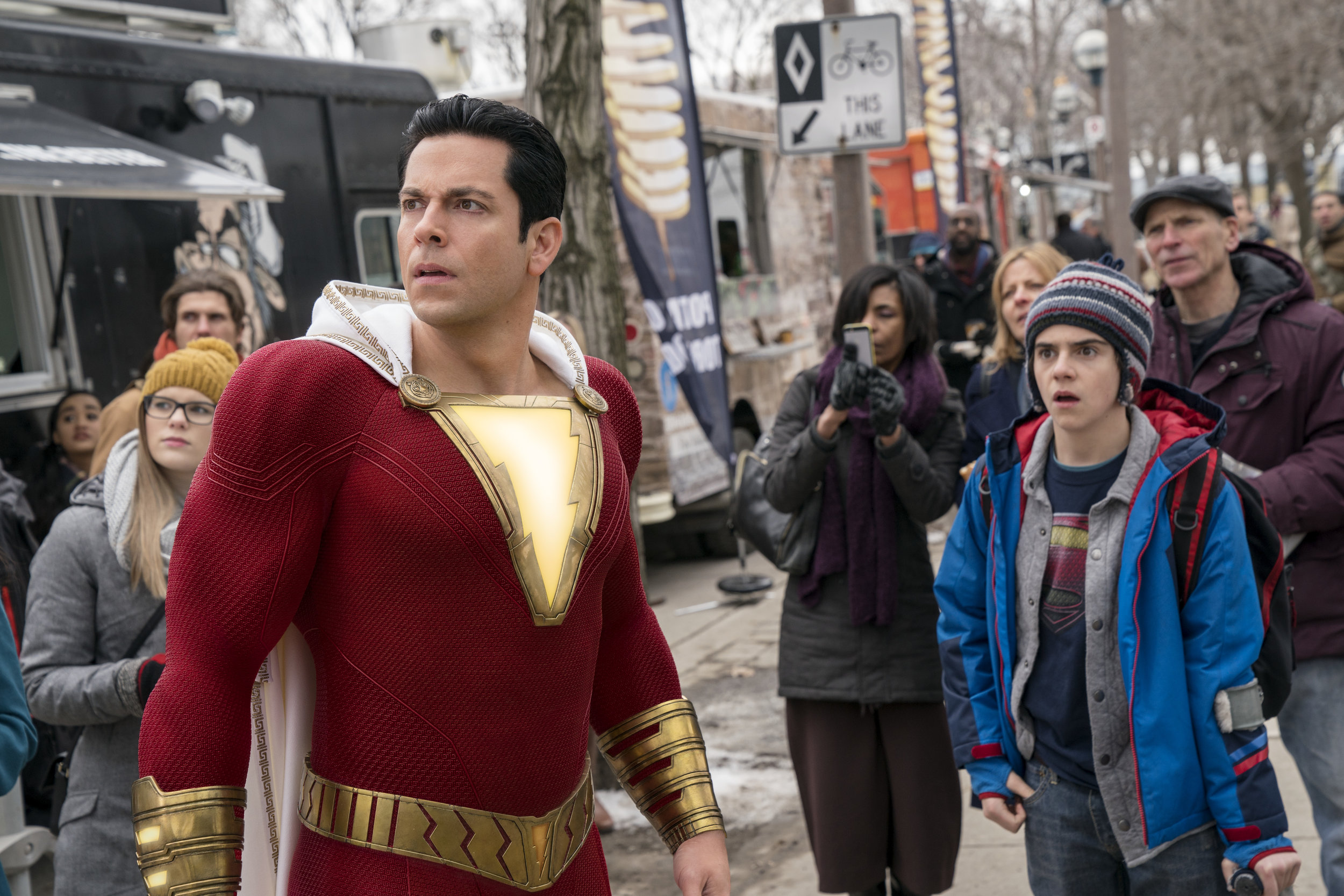 Zachary Levi and Jack Dylan Grazer in an enthusiastically punctuated superhero comedy.