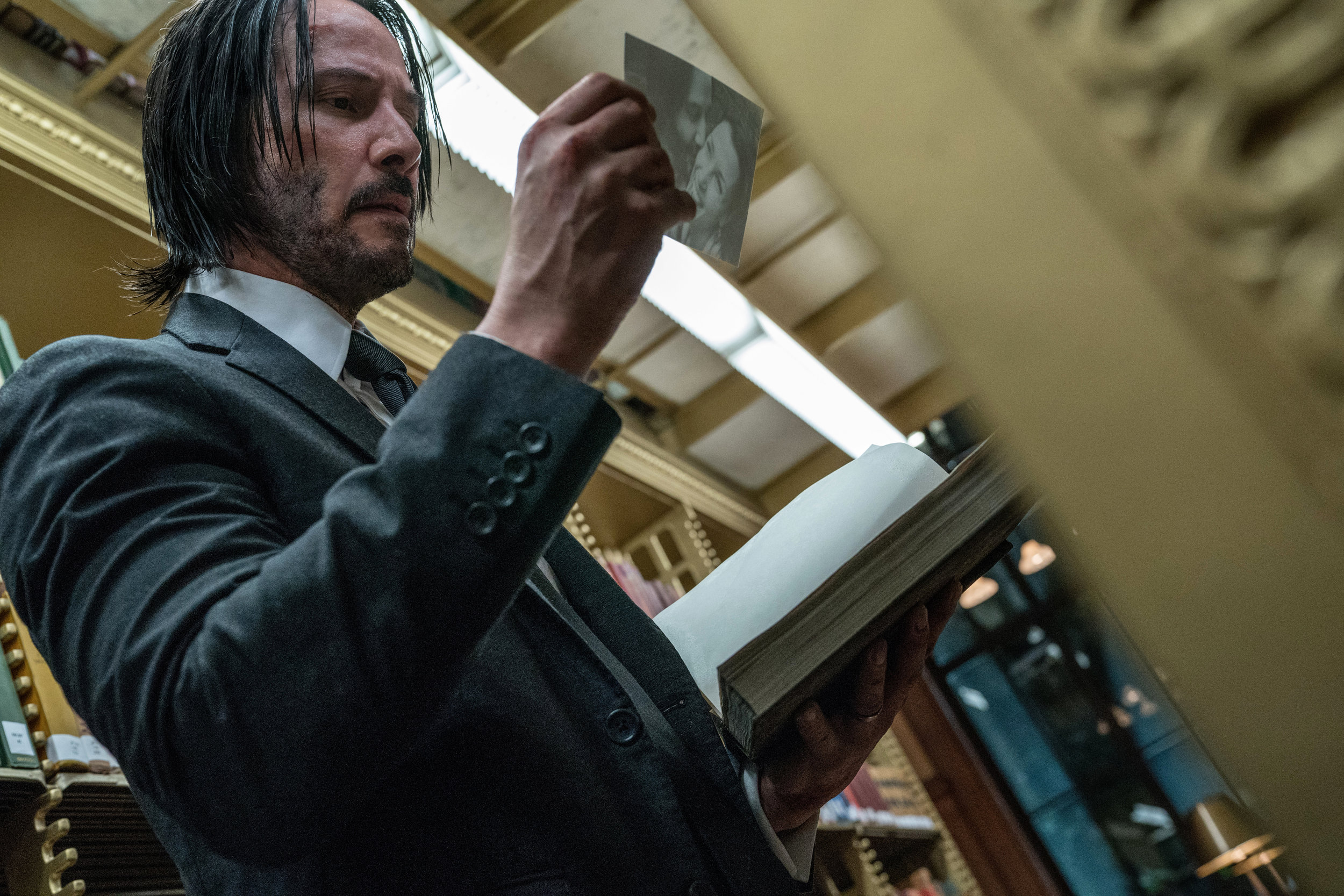 Unretired assassin John Wick (Keanu Reeves) still mourns his wife (Bridget Moynahan).