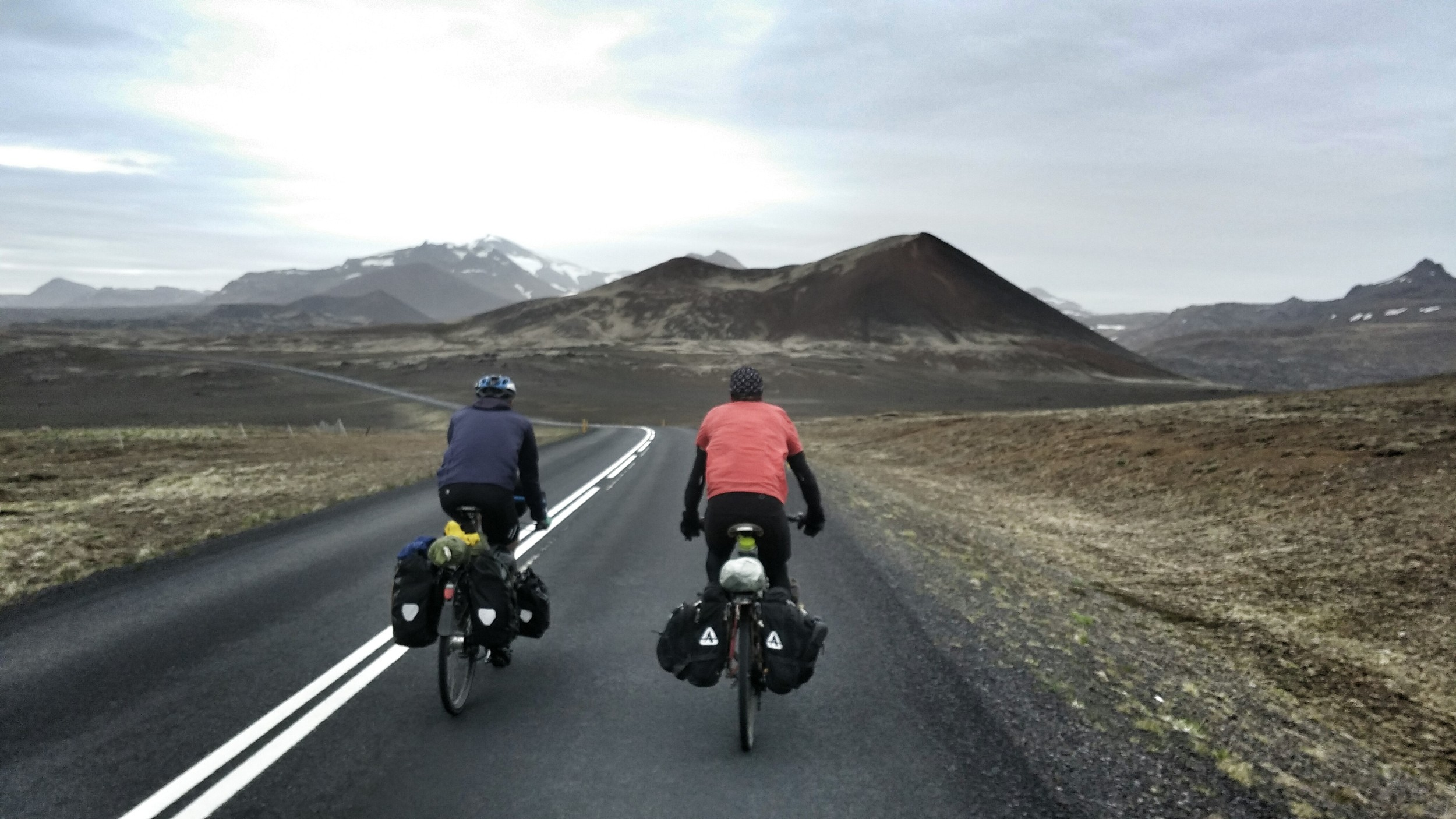 My cousin and I cycled up to Will, on the right, who came to Iceland from Scotland. We all cycled a few kilometers together, got to know each other and then cycled off. It's always a thrill running into fellow cyclists. You'd never see two cars meet like this, cycling keeps things personal. We later ran into Will in Reykjavik a week and a half later and shared stories.