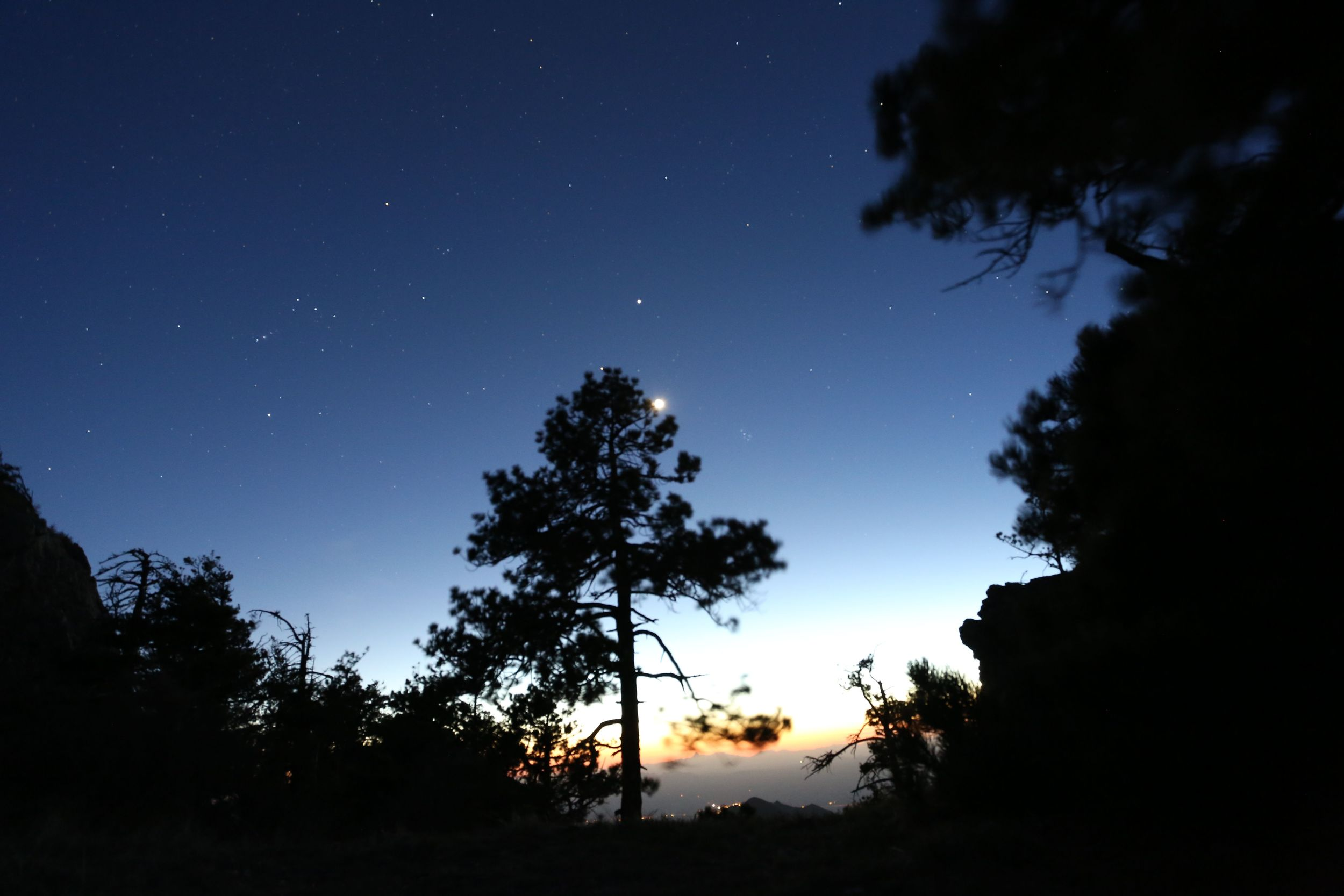 Southern Arizona is well known for its clear night skies and good night time star gazing.  Here Orion and a crescent moon set in the west, soon after sunset.