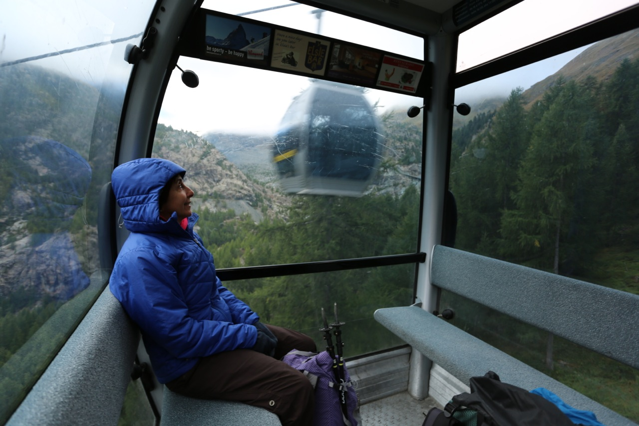 Karen rides the gondola from town up into the clouds.