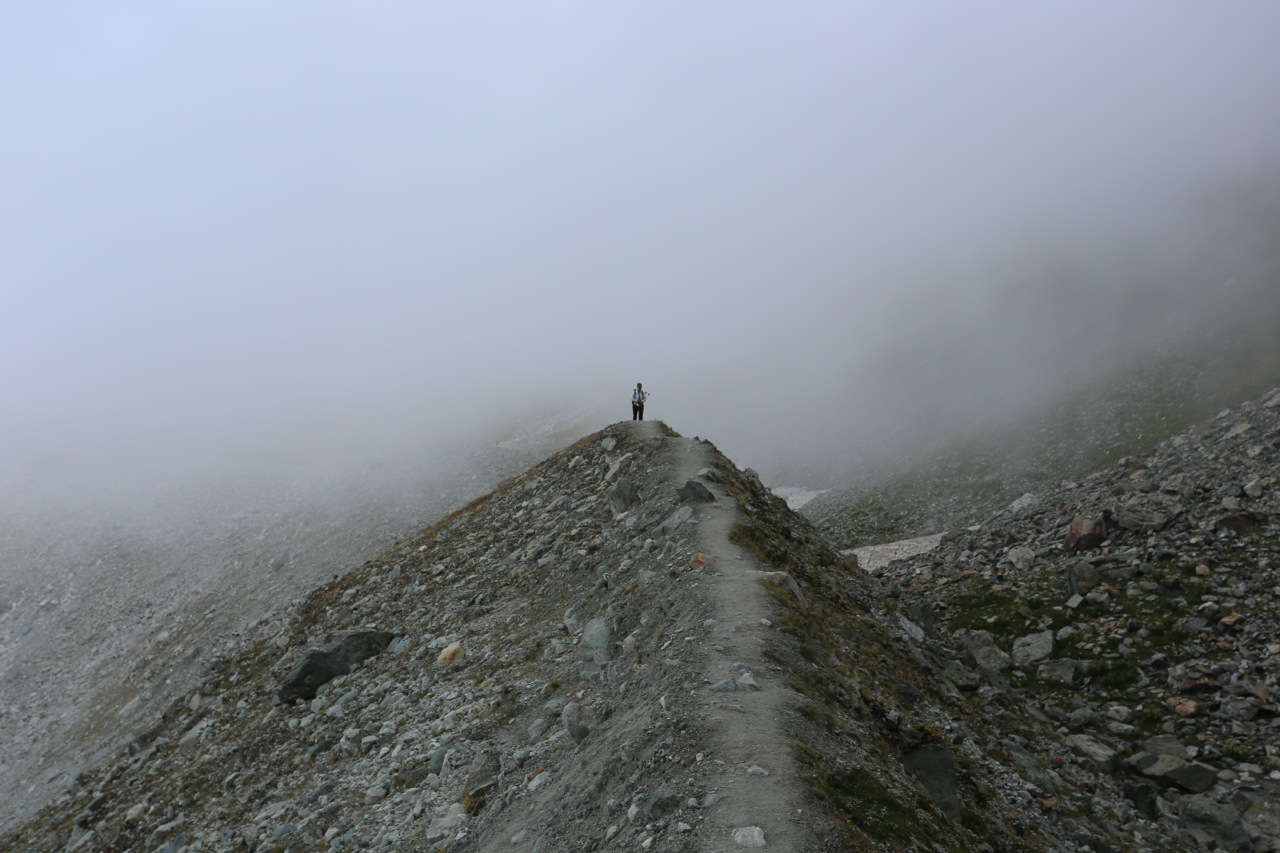 As we approached the Moiry glacier, we had to hike along the sharp ridge of this lateral moraine as the weather closed in.