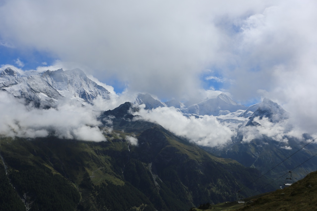 The Weisshorn peaks through the clouds.