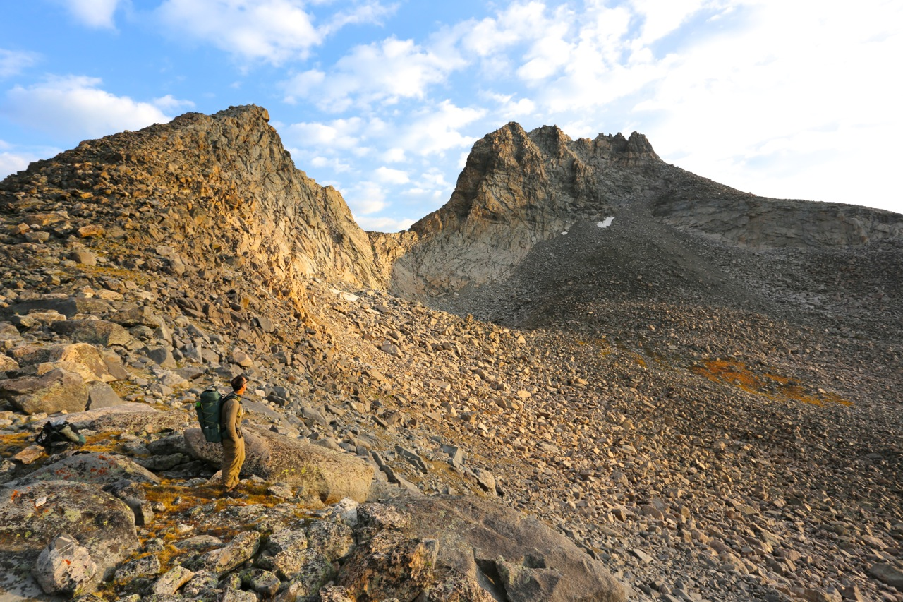 Alan gazes at impressive Mount Bonneville before beginning the descent through the massive talus field below the pass.