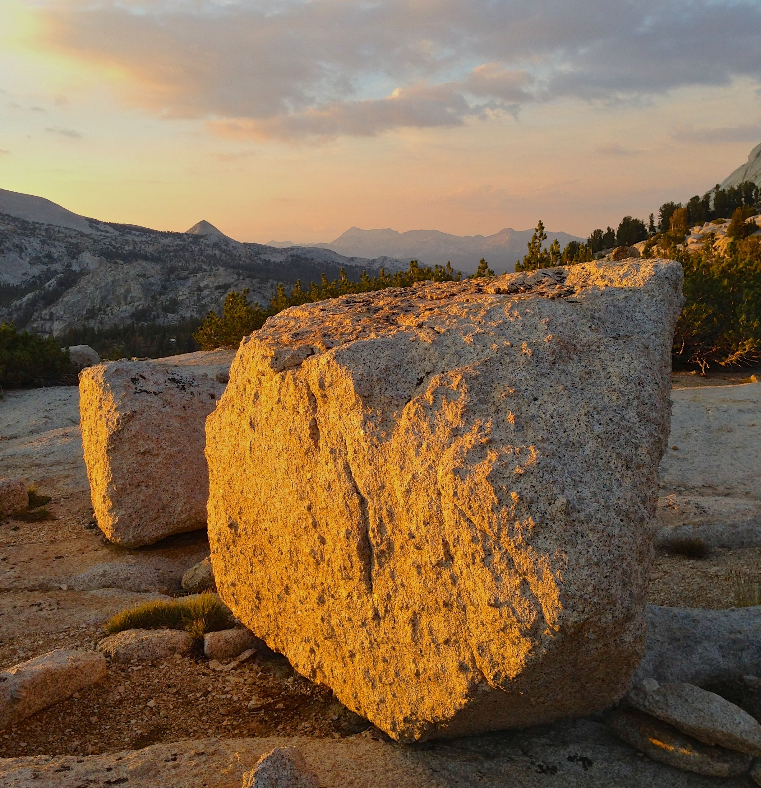 Sunset shines golden light onto boulders near Vogelsang Lake, Yosemite National park.  Photo taken with an iPhone 5 on my Sierra High Route hike in summer 2013.