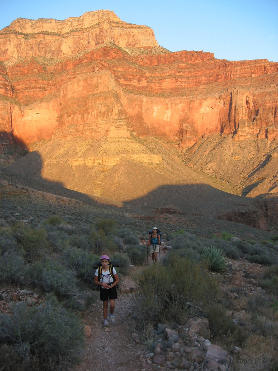We rose in the dark and left Hermit Creek very early, about 430 am. Here Amy and Karen hike along the trail toward Monument Creek.