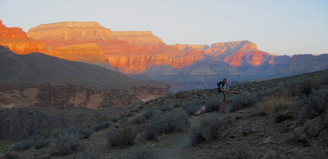 Megan and sunrise. The hike along the Tonto Plateau is almost completely flat, but zig-zags along the rim of the plateau to work around large side canyons and drainages.