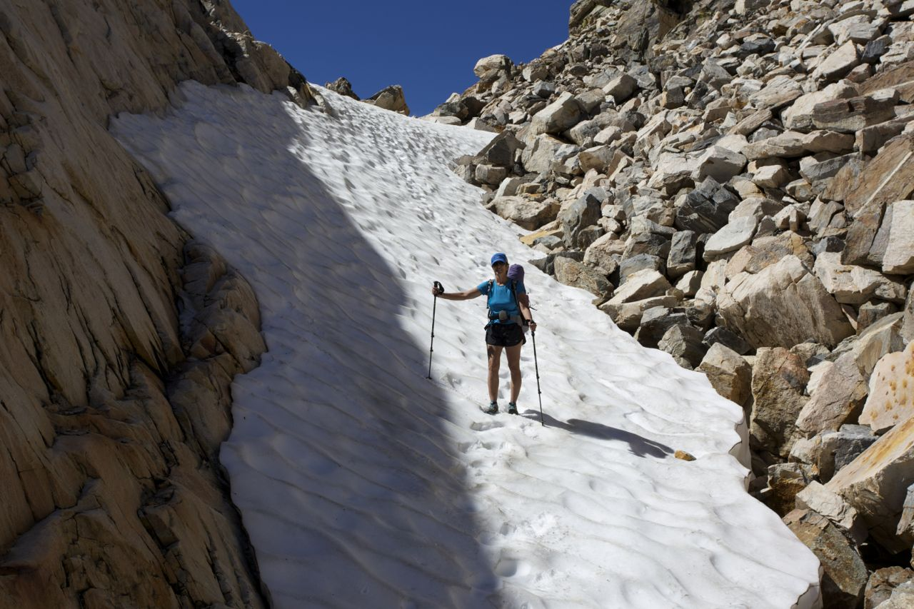 Karen descends the first snow chute below Horse Creek Pass.