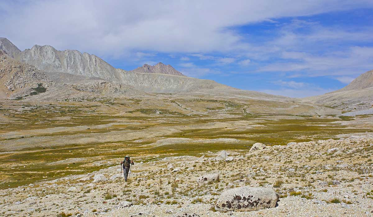 Alan on the approach to Wright Lakes Pass. Shepherd Pass lies in the saddleat the right side of the photo.