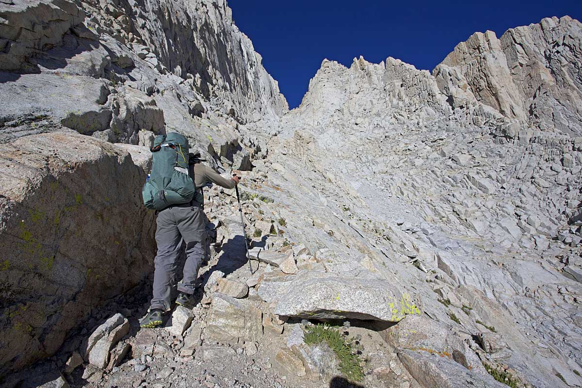 Alan slogs his way upsteep, loose scree on the Mountaineer's Route. The climb of Whitney and traverse across its southern ridge is a highlight of the SoSHR.