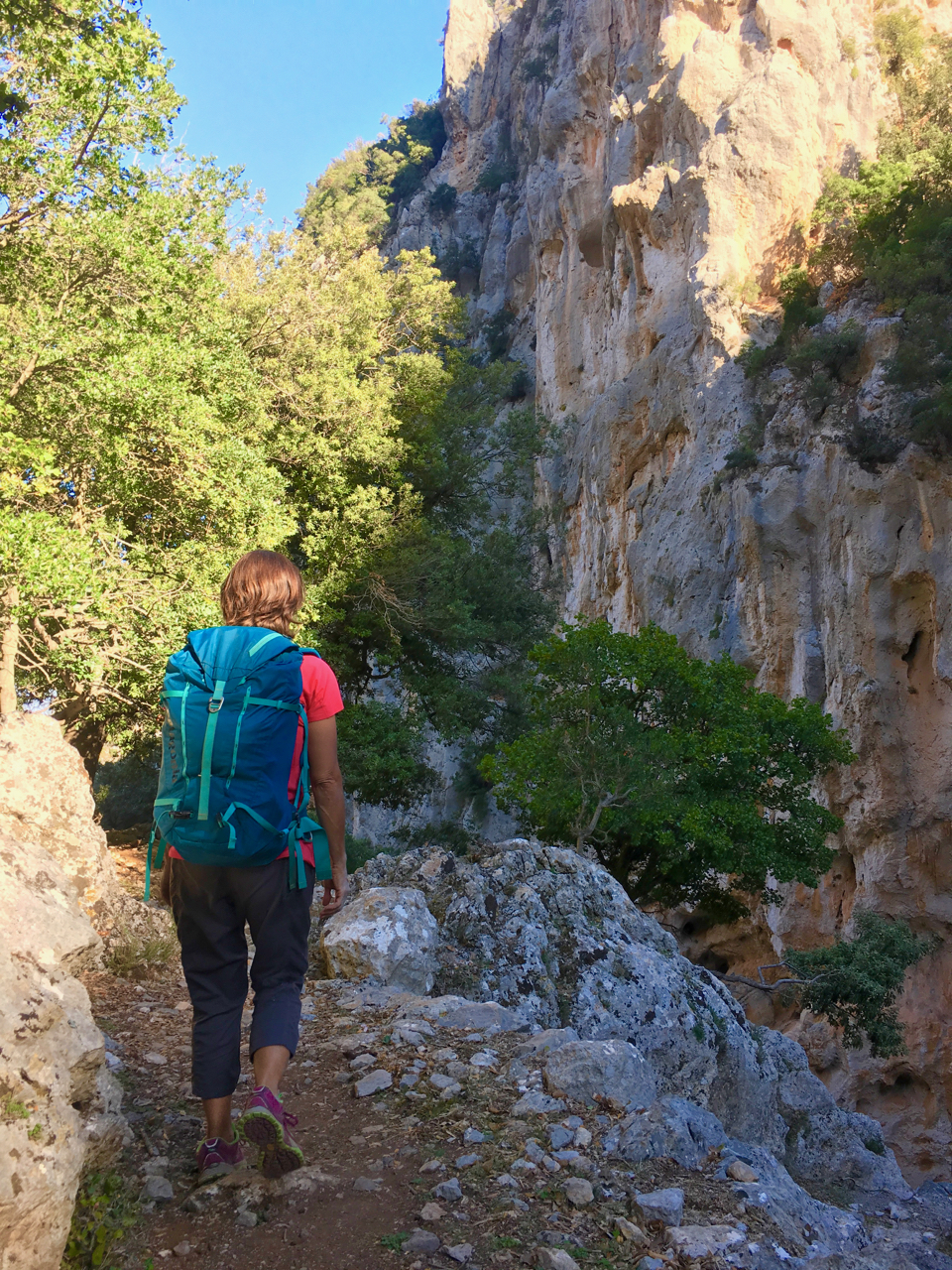 Karen hikes through the canyon of Saint Nicolas. This is a lush and beautiful canyon that is worth the visit for the climbing, the hiking, the striking monastery, and the exciting drive to and from town.