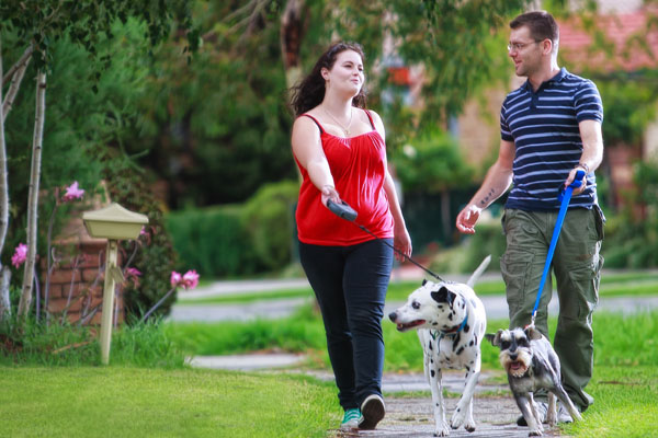 couple-walking-dog-in-park1.jpg
