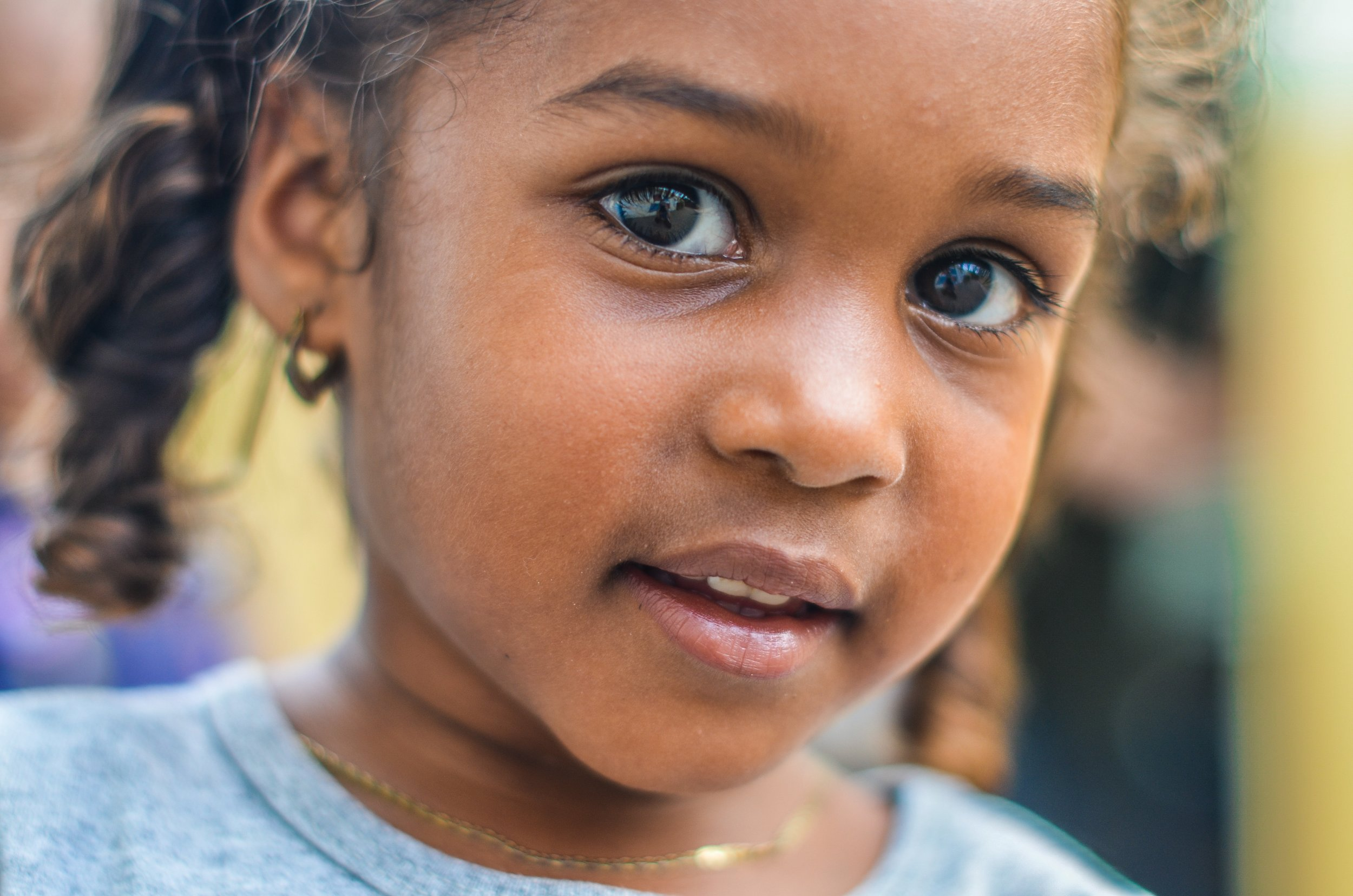 toddler girl with pretty brown eyes  blue shirt michael mims Up cW.jpg