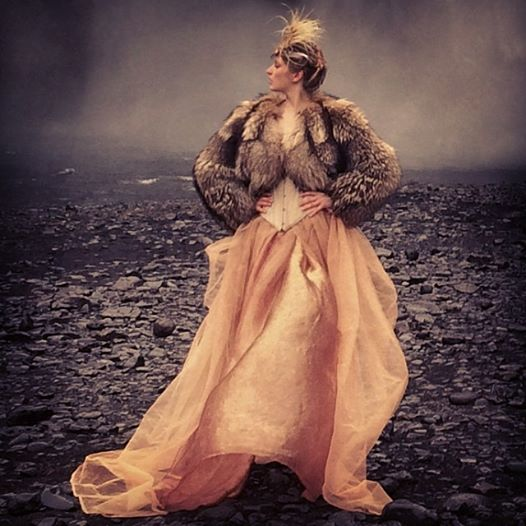 When it rains, use the iPhone.     Model: Elena Sirina Stylist: Minna Attala Hair and make-up: Grace Gray Fur coat and headdress: National Theatre Corset: Stylist's own Skirt from the stylist's studio