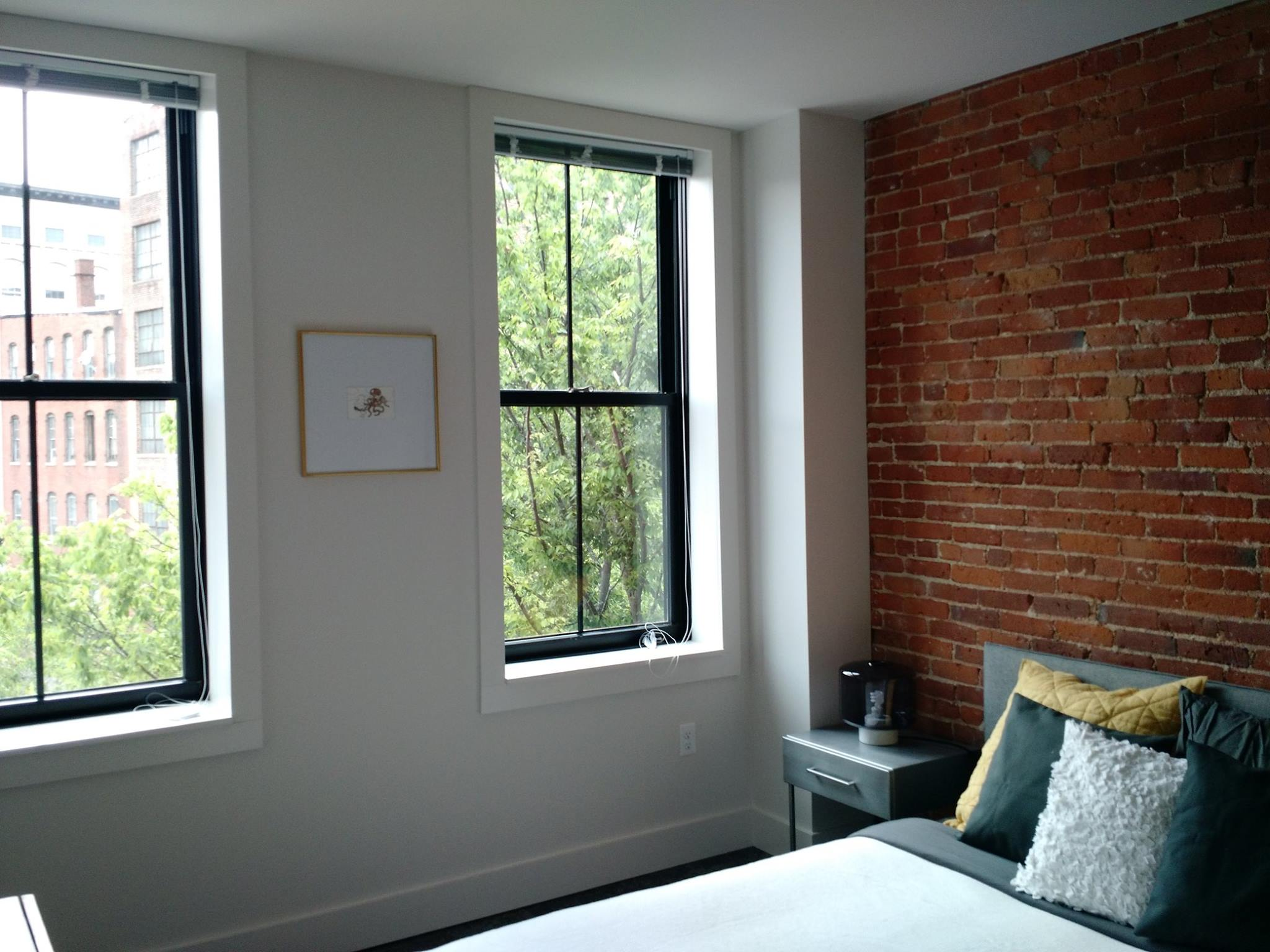 Exposed brick and beam, tall ceilings, create amazing living spaces at JM Lofts.