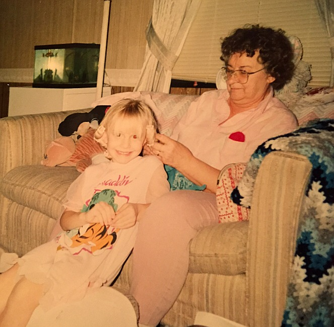 This is my grandma. Putting my hair in rollers and me cheesing while wearing (of course) my favorite Aladdin night gown. Pictured in back (per most photographs between the ages of 1-10) is my beloved Mickey Mouse. I don't think there's much of a story here outside of the fact that I probably wanted my hair curled because grandma did her own, and more than likely, those curls fell flat about 20 minutes later.