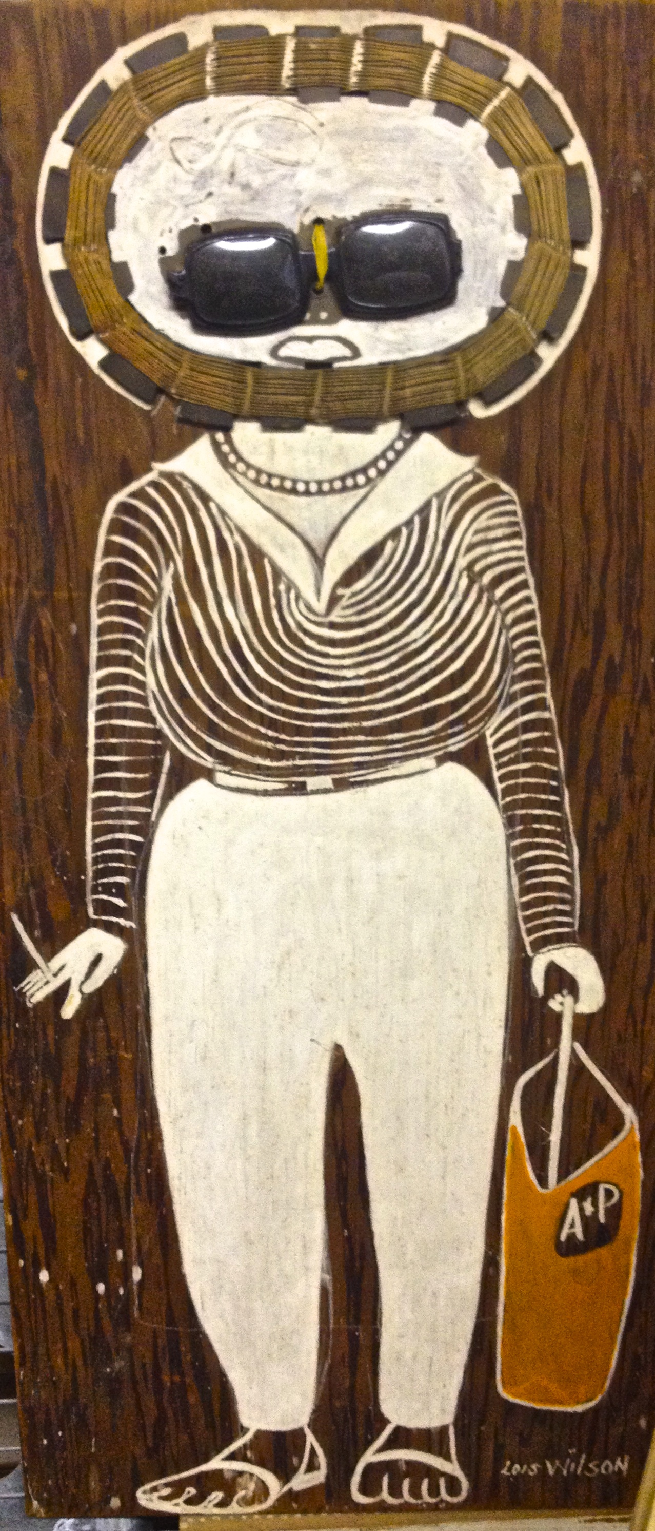 Lois Wilson, painting of a woman. She had hundreds of paintings of all sorts of people, all painted on found pieces of wood.