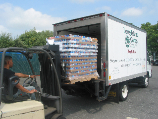 A Long Island Cares truck is loaded with canned dog food for delivery to pantries in Nassau and Suffolk.