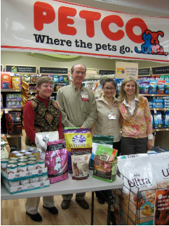 """Jane Hoffman, President of the Mayor's Alliance for NYC's Animals, Steve Krall and Arissa from PETCO 86th Street and Susan Kaufman, President of ARF! at the opening of PETCO's """"We Are Family Too"""" program to benefit Food Bank For New York City"""