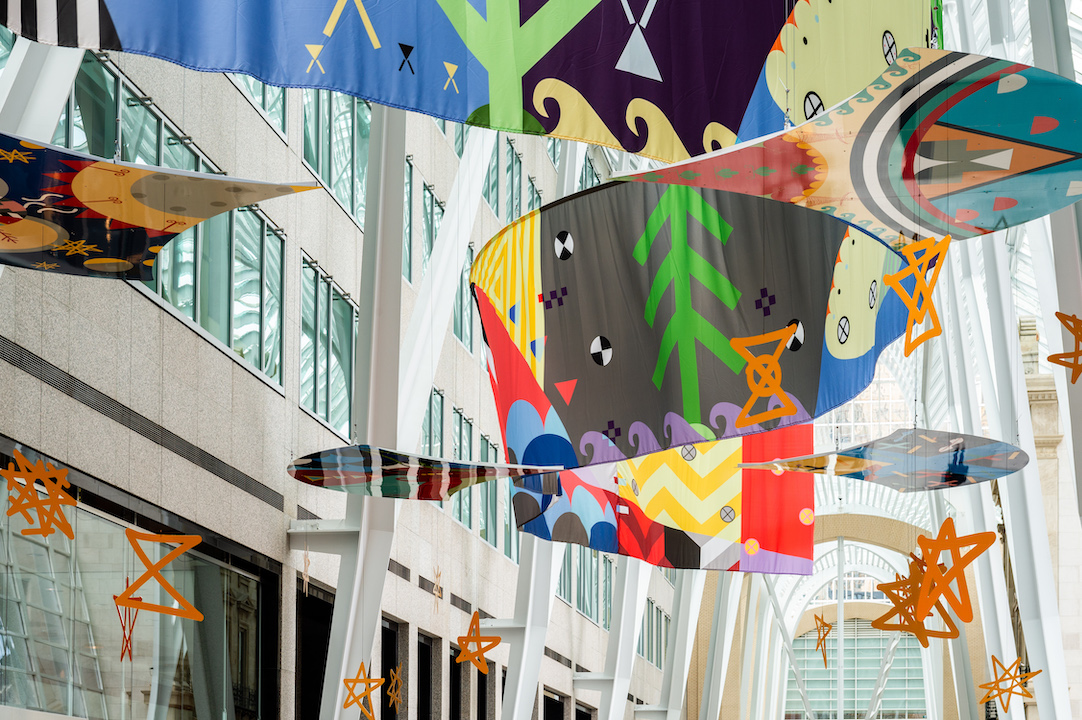 Tepkik, 2018    Materials:  Print on Polysilk, 3M reflective print on Aluminum panels  Dimensions:  100'x40'x25'  Photo:  Ernesto Di Stefano  Installation commissioned by Brookfield Place Toronto.  Produced by Pearl Wagner Art Consultants.  Project managed by  IOTA STUDIOS