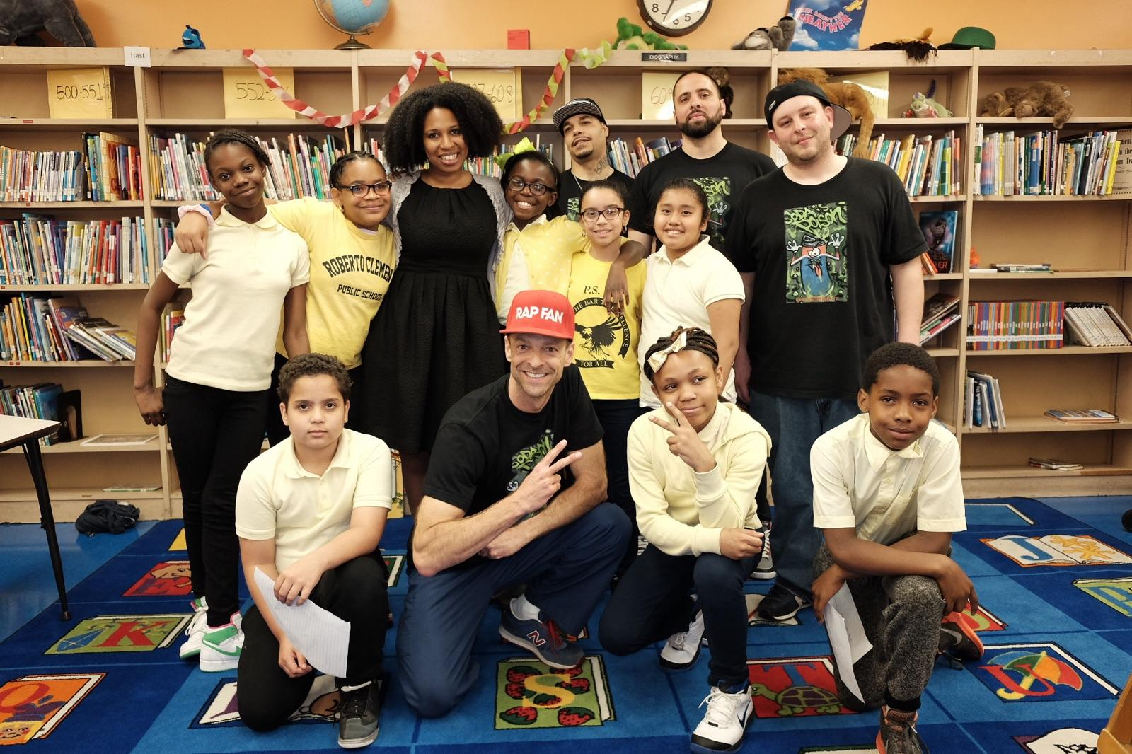 Dr. Kevin Strong with Operation: #DEFEATSODATRON in collaboration with NYC Health Department. Pictured here with Dr. Aletha Maybank, Deputy Commissioner, NYC Dept of Health and Mental Hygiene and Founding Director of the Center for Health Equity with students at PS 13 and Dunk the Junk rappers, Jay Caron and Mike Be.