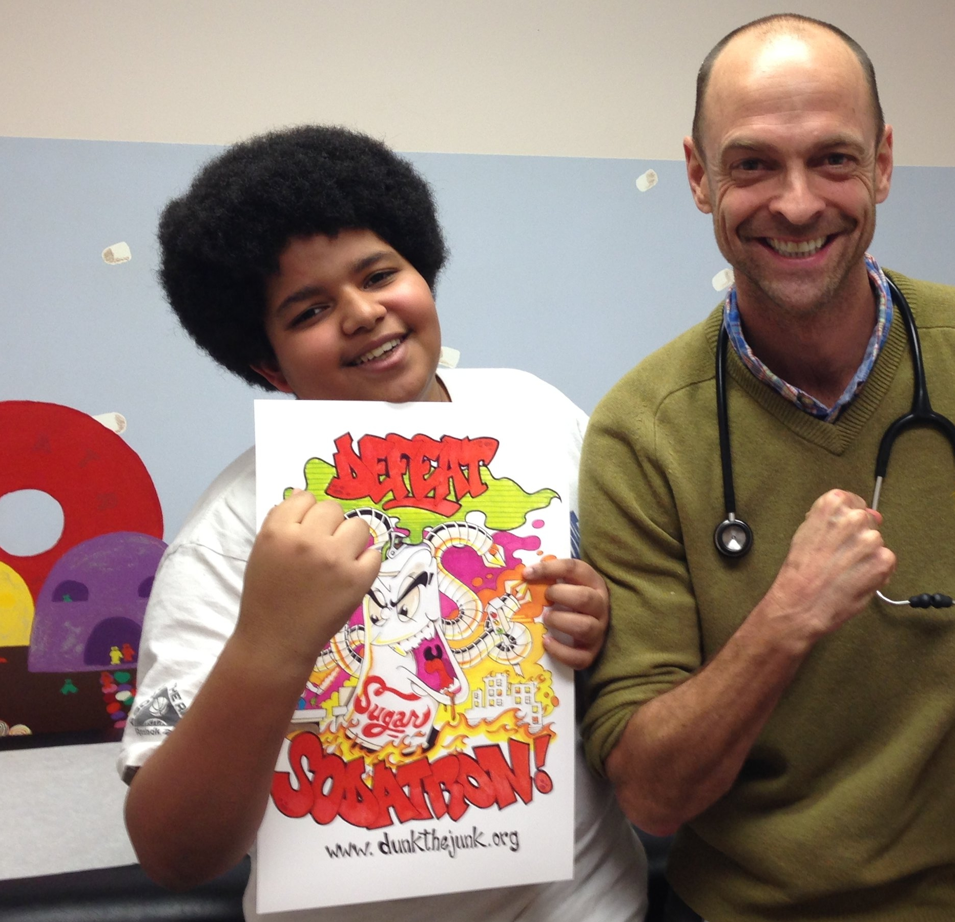 Dr. Kevin Strong celebrates with a proud, soda free patient.