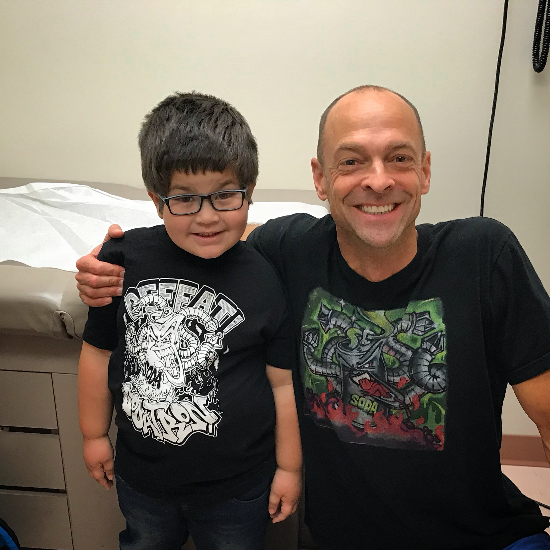 Dr. Kevin Strong celebrates with a proud patient who has one year soda free.
