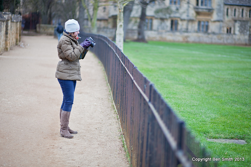 Victoria checks her camera settings on a photography tuition session in central Oxford.