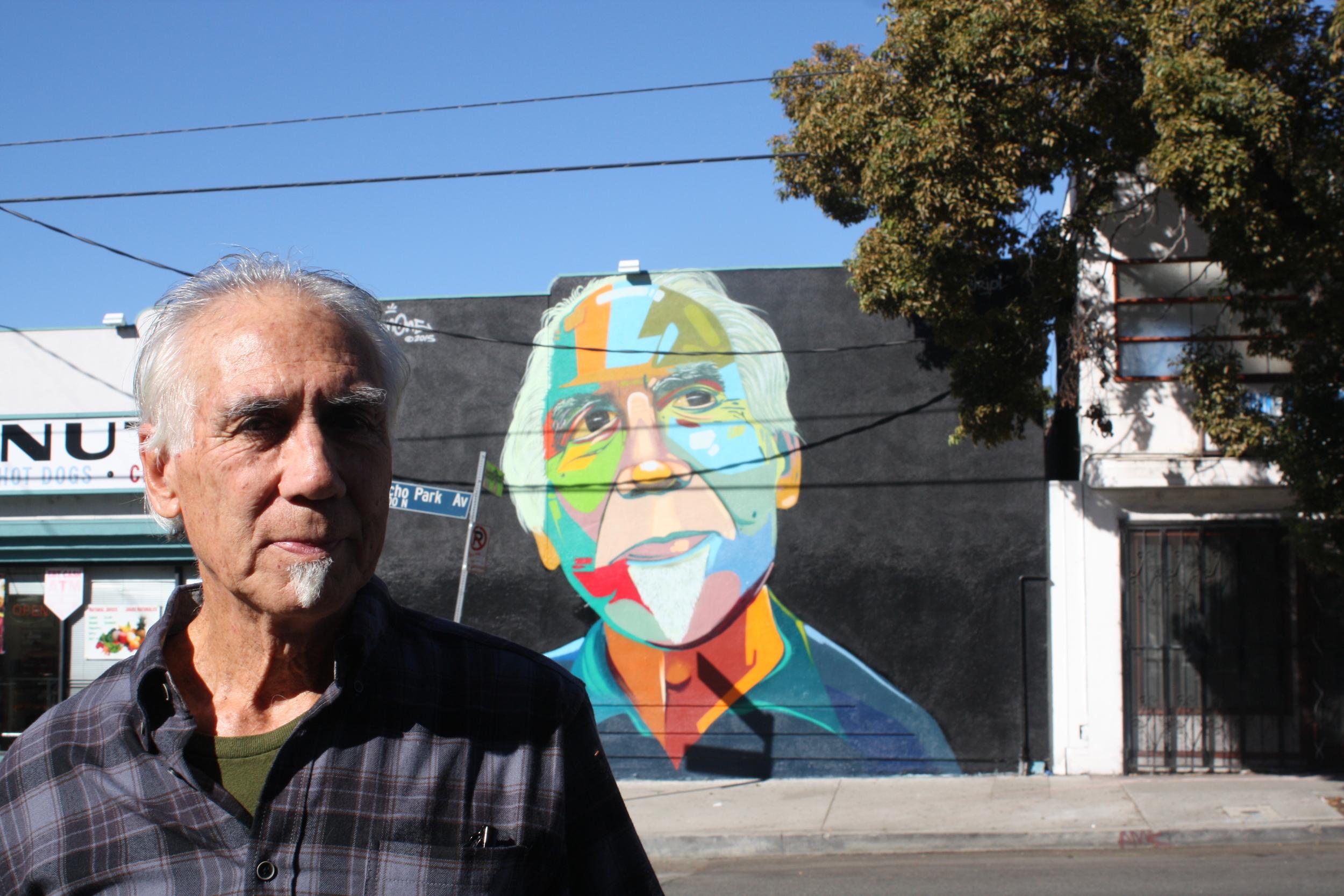 Eriberto in front of my mural.