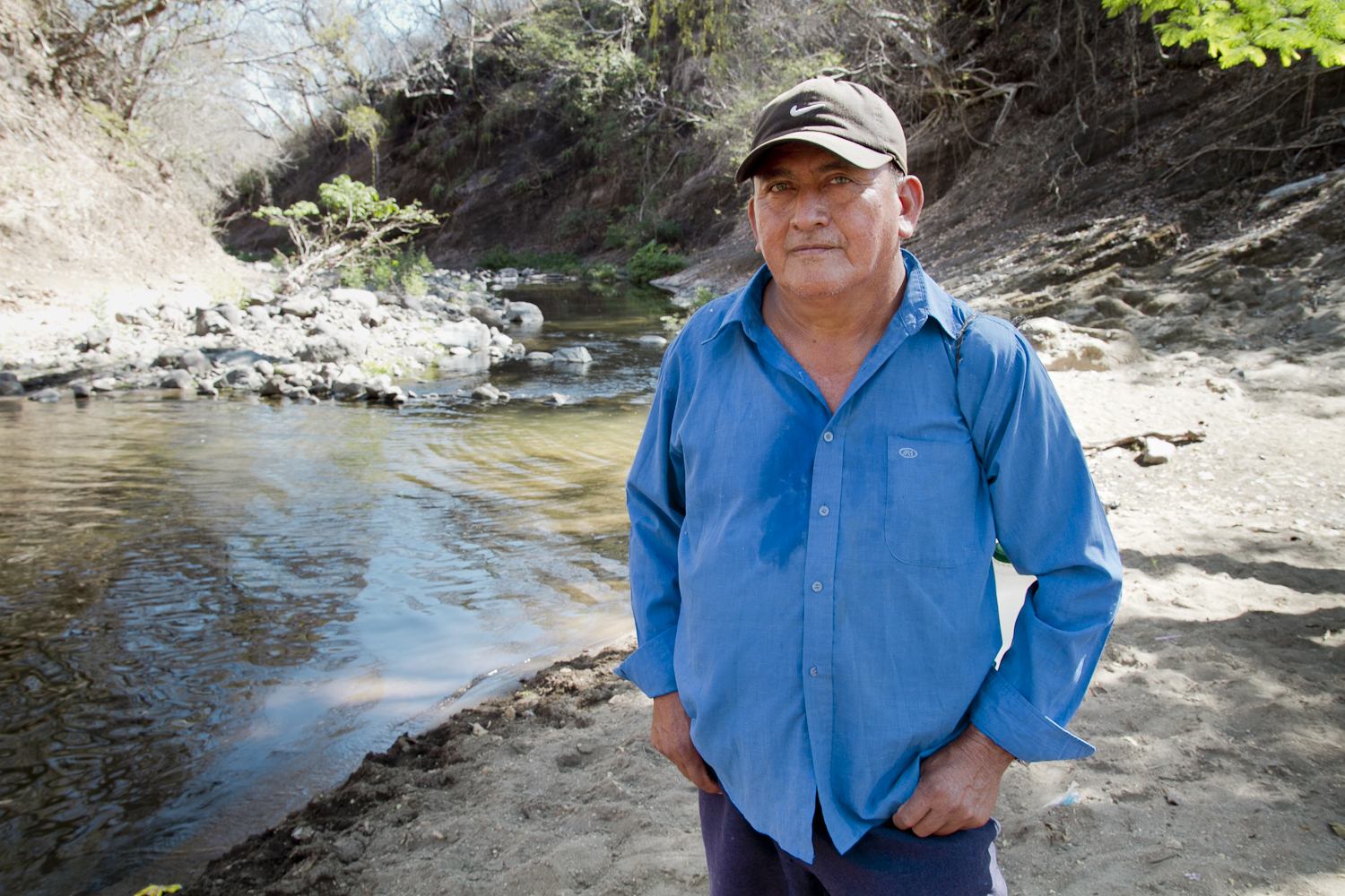 """Símeón Alvarez was one of the first to return to Amatitán 10 years after  the massacre took place. At the Río Amatitán (Amatitán River), Alvarez  says he found bloodied clothing of those murdered by the military police at the river, and that  years later, blood still stained the rocks at the riverside. Today, a  monument stands at the river with the names of those murdered in the  1982 massacre, which is now remembered as """"El Calabozo,"""" or The Dungeon."""