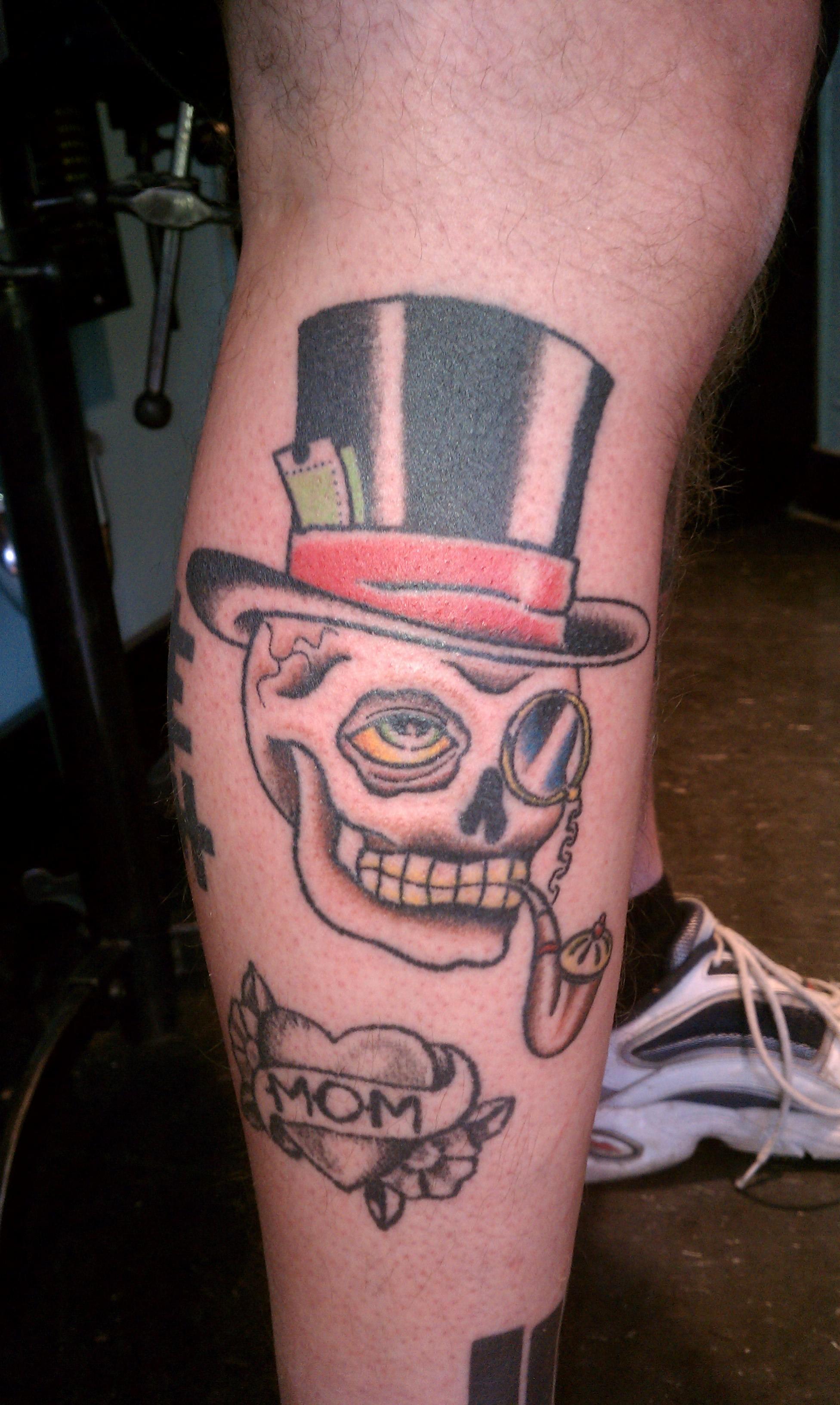 Hand poked skull tattoo by Tracy Zumwalt