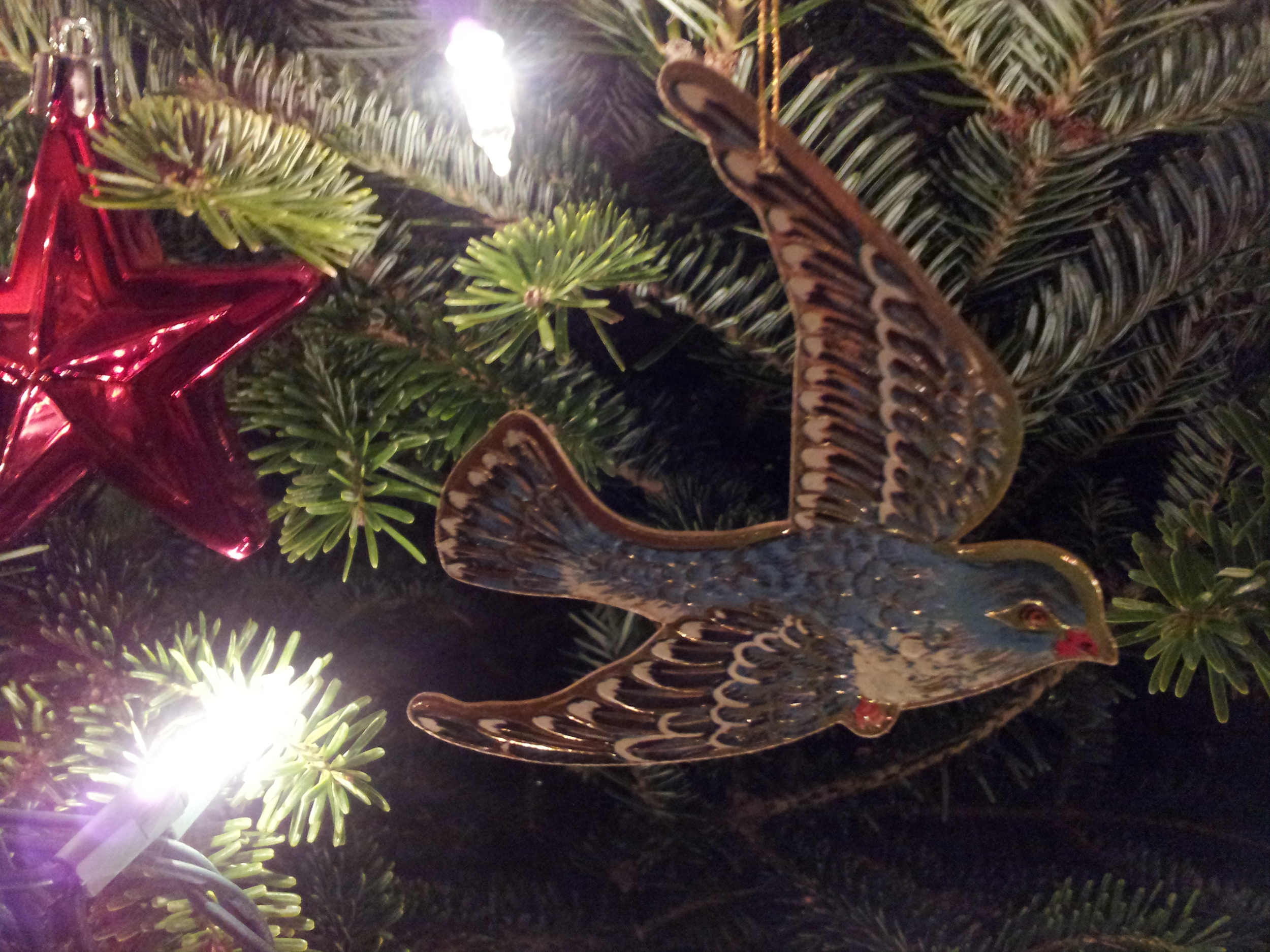 Golden bird on the Inn at West View Farm Tree