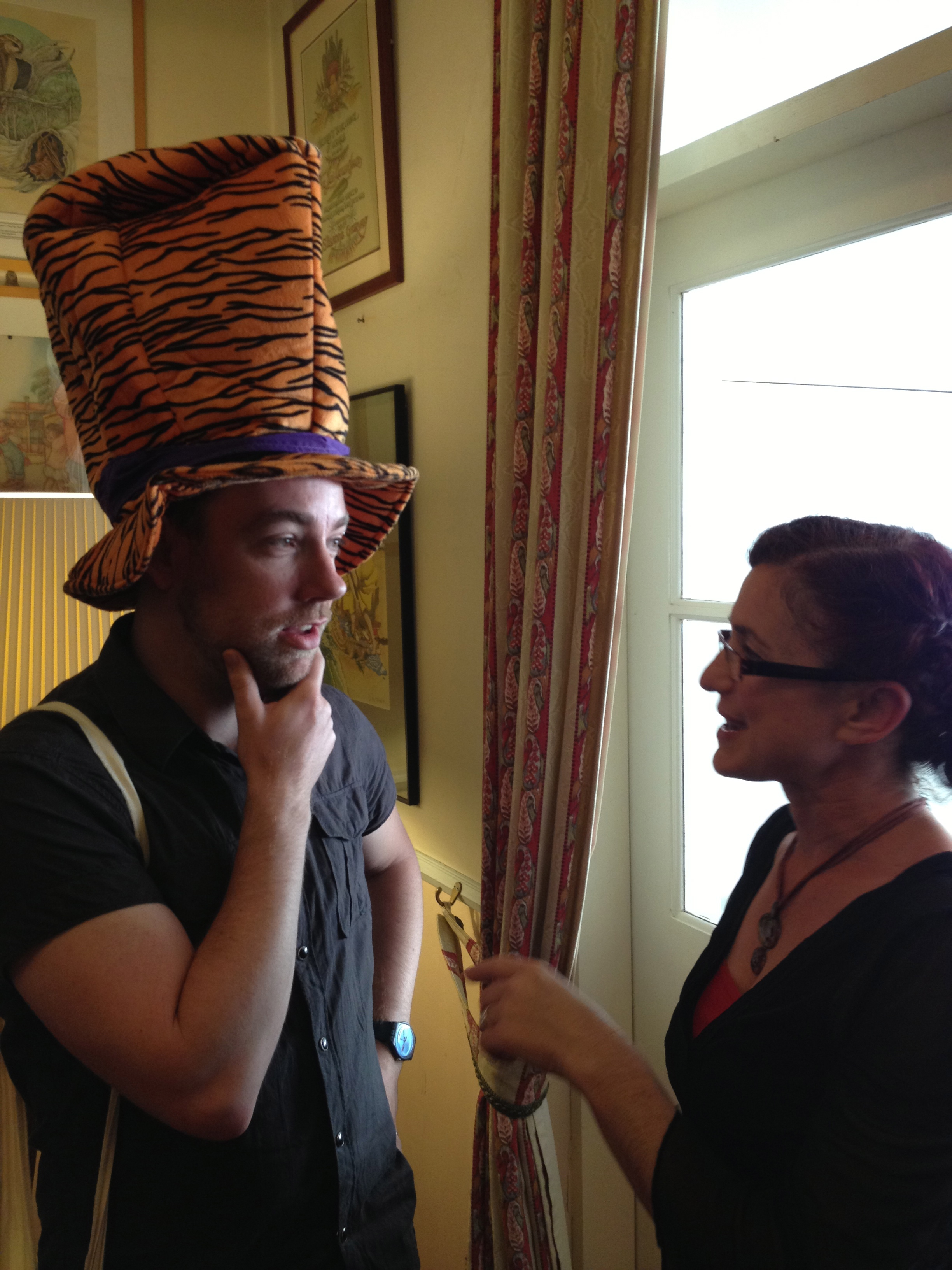 Deb Abela  telling  Nathan Luff  off for skinning an endangered animal to make something as frivolous as a hat.