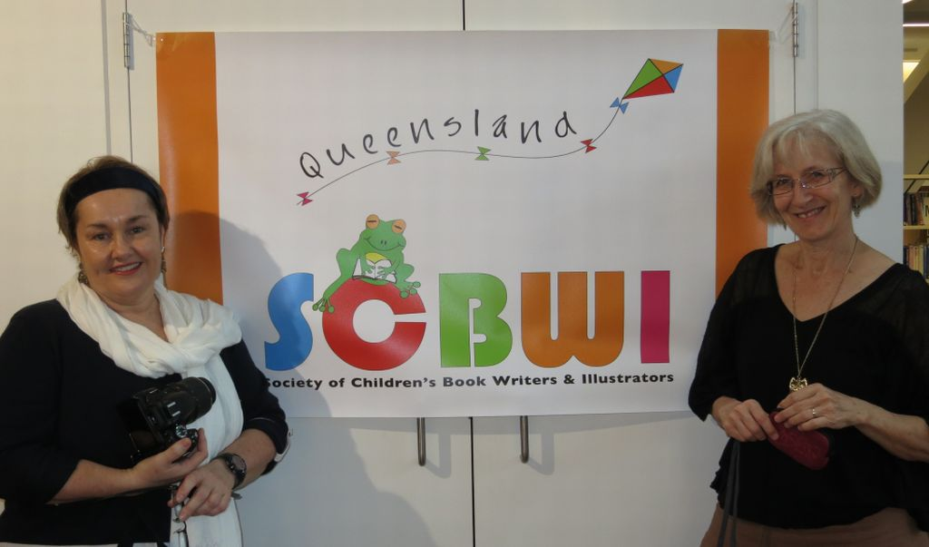 Our new outdoor/indoor banner with its designer, Lynn Priestley.