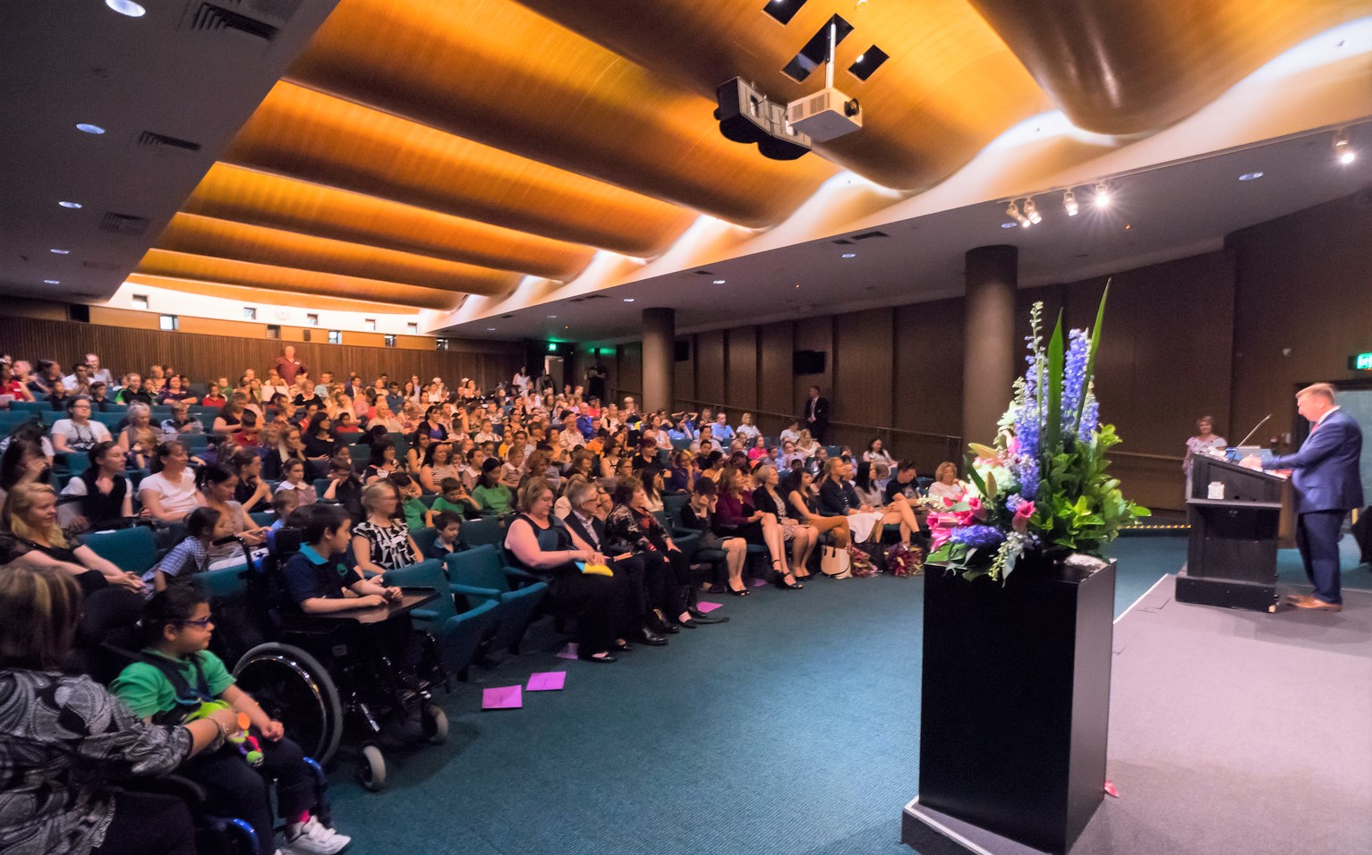 This is the Chief Minister's Reading Challenge closing ceremony at the National Library of Australia, November 2016. I'm sitting front row far right, white skirt, with my fellow ambassadors, as we celebrate a year of reading. The audience is a beautiful bevy of teacher/librarians from all over the Canberra Region. Tens of thousands of children took part in CMRC in 2016, and the initiative continues to grow.