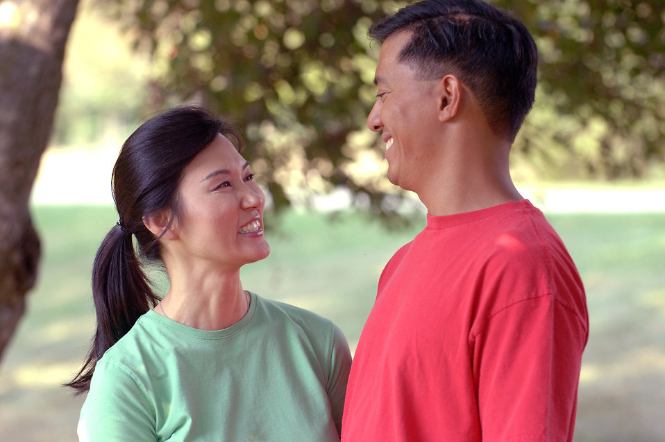 17066-an-asian-couple-smiling-at-each-other-outdoors-pv.jpg