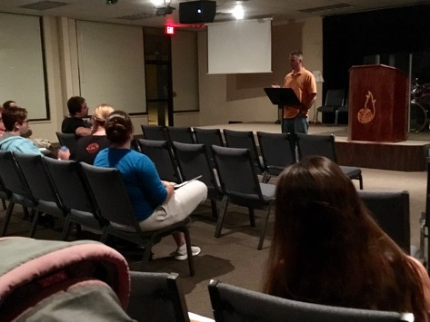 Adam McFeaters leads a bible study during the all-night prayer meeting.