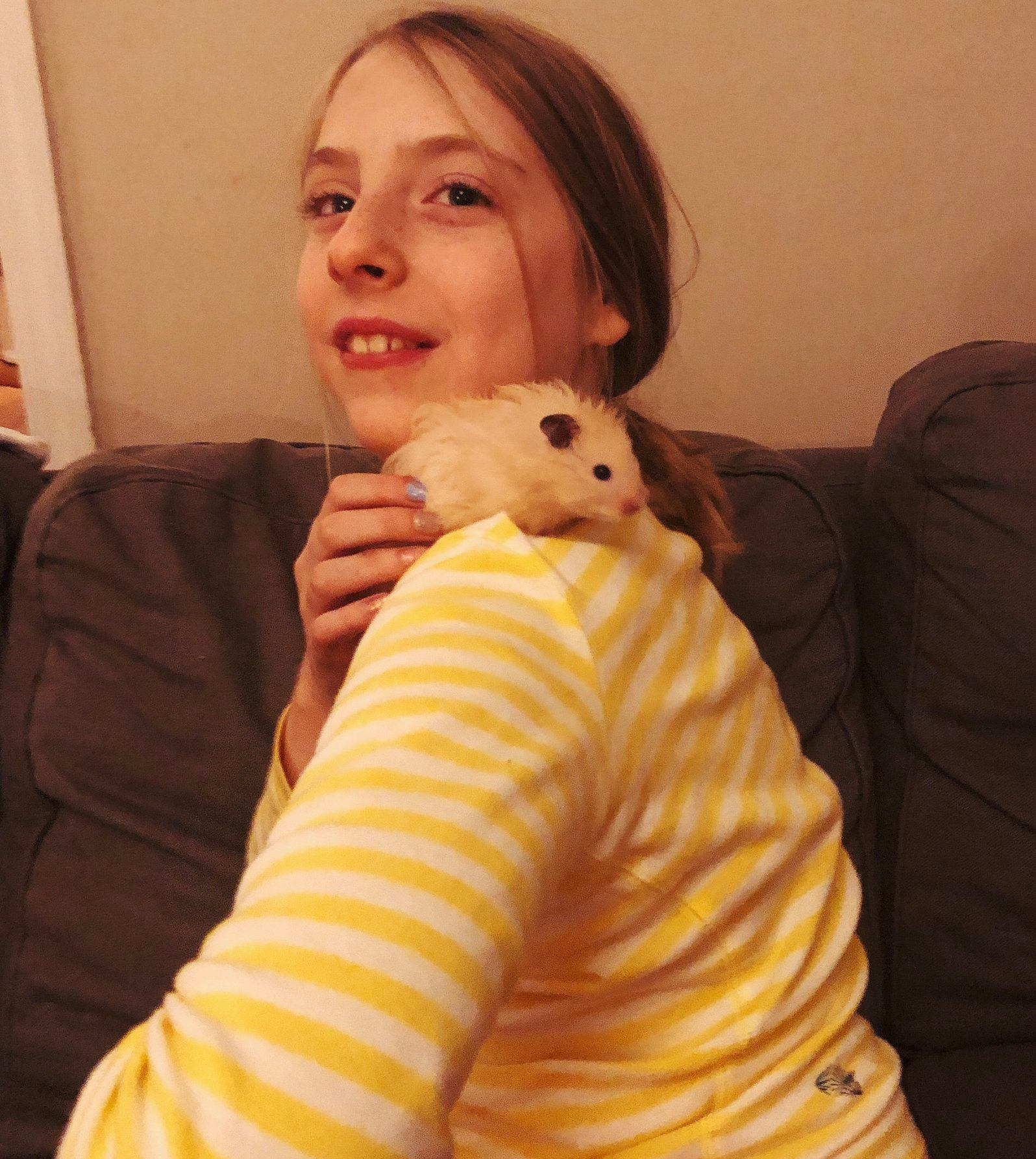 Nina and her hamster, George