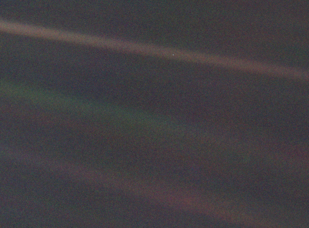 This image of Earth is one of 60 frames taken by the Voyager 1 spacecraft on February 14, 1990 from a distance of more than 6 billion kilometers. In the image the Earth is a mere point of light, a crescent only 0.12 pixel in size. Our planet was caught in the center of one of the scattered light rays resulting from taking the image so close to the Sun.