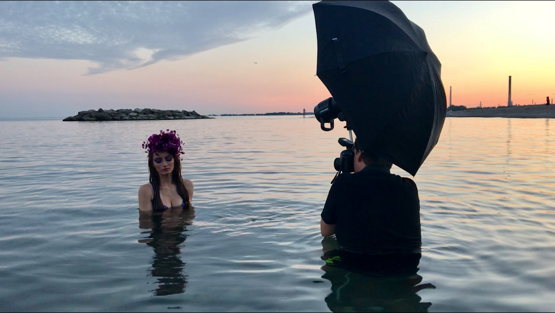 Behind-the-scenes image of the Rusalka shoot at Lake Ontario in Toronto, Canada, with photographer Pedro Bonatto and model Alona Lytt.  BTS photo by Gloria Caballero.