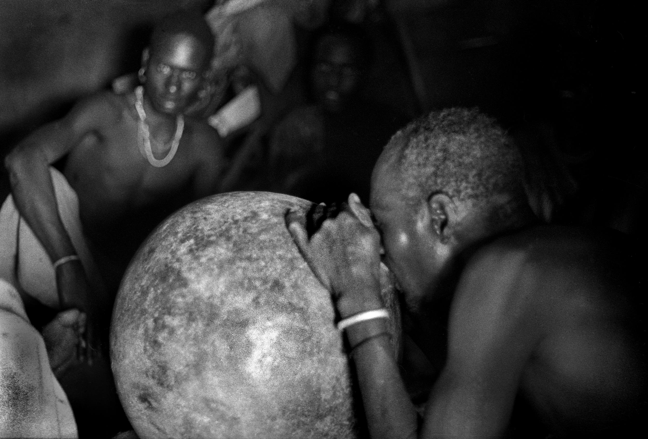 Karamojong warriors drinking sorghum beer, Uganda