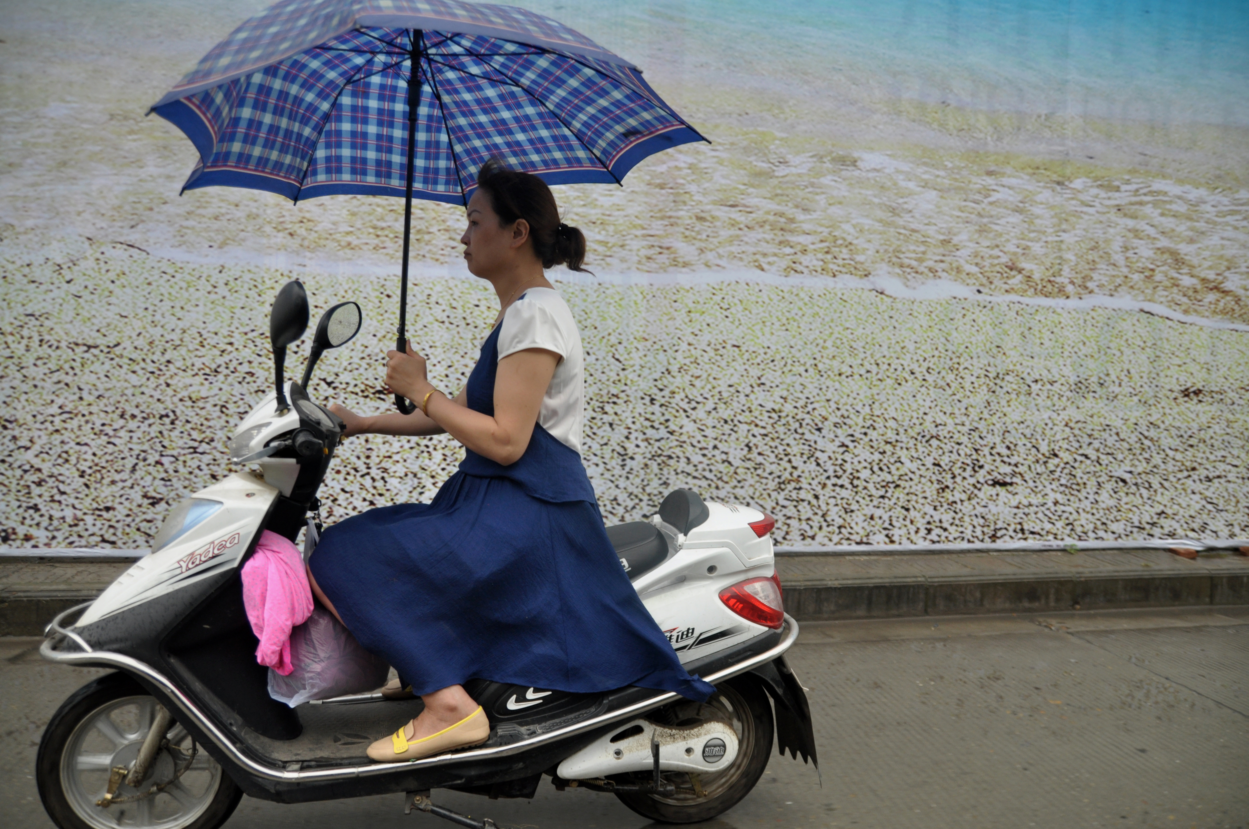 WOMAN ON SCOOTER.jpg