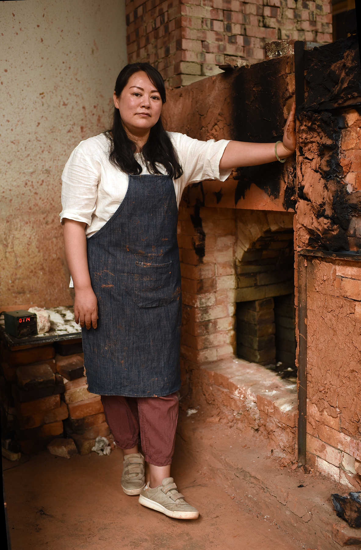 Pan Juan, Inheritor of Purple Pottery Intangible Cultural Heritage, Jianshui, Yunnan Province.